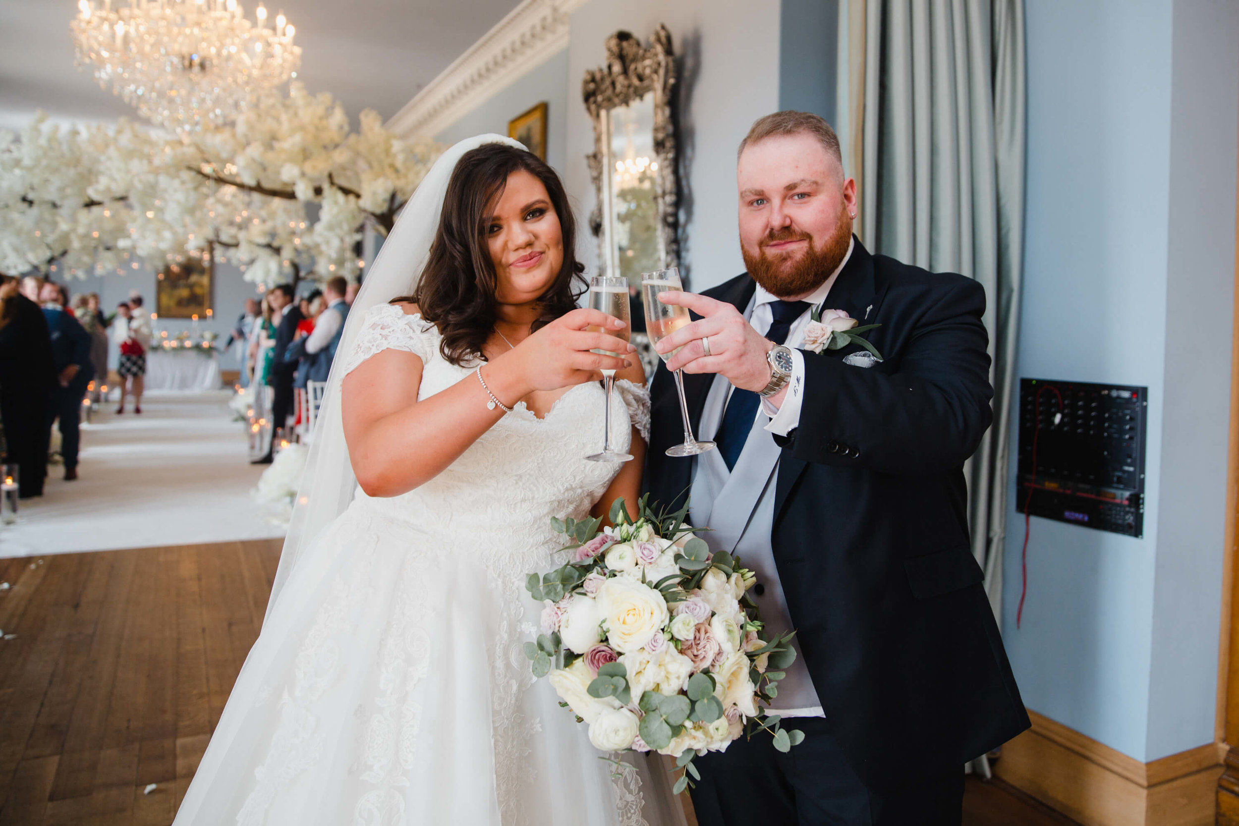newlyweds sharing a glass of champagne together after ceremony concludes