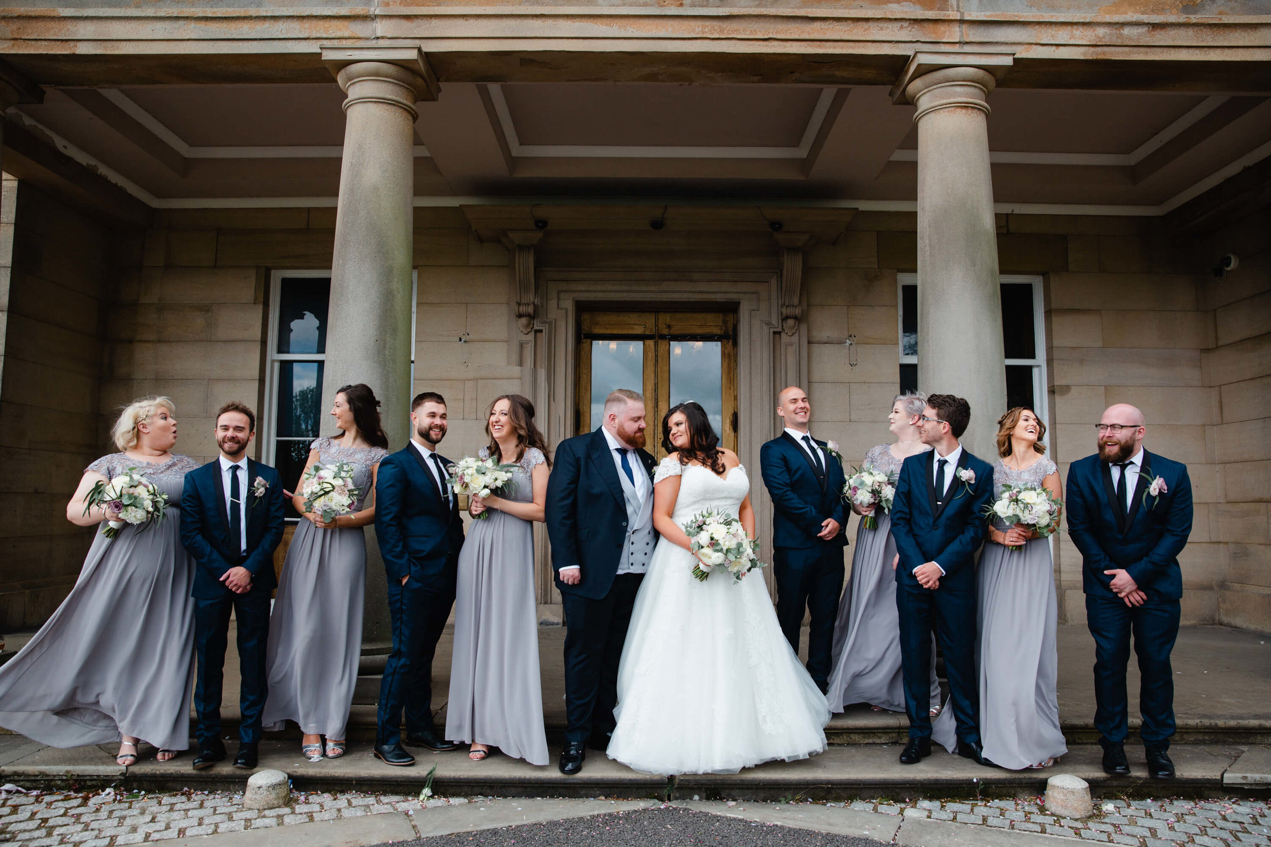 bridal party portrait in front of haigh hall