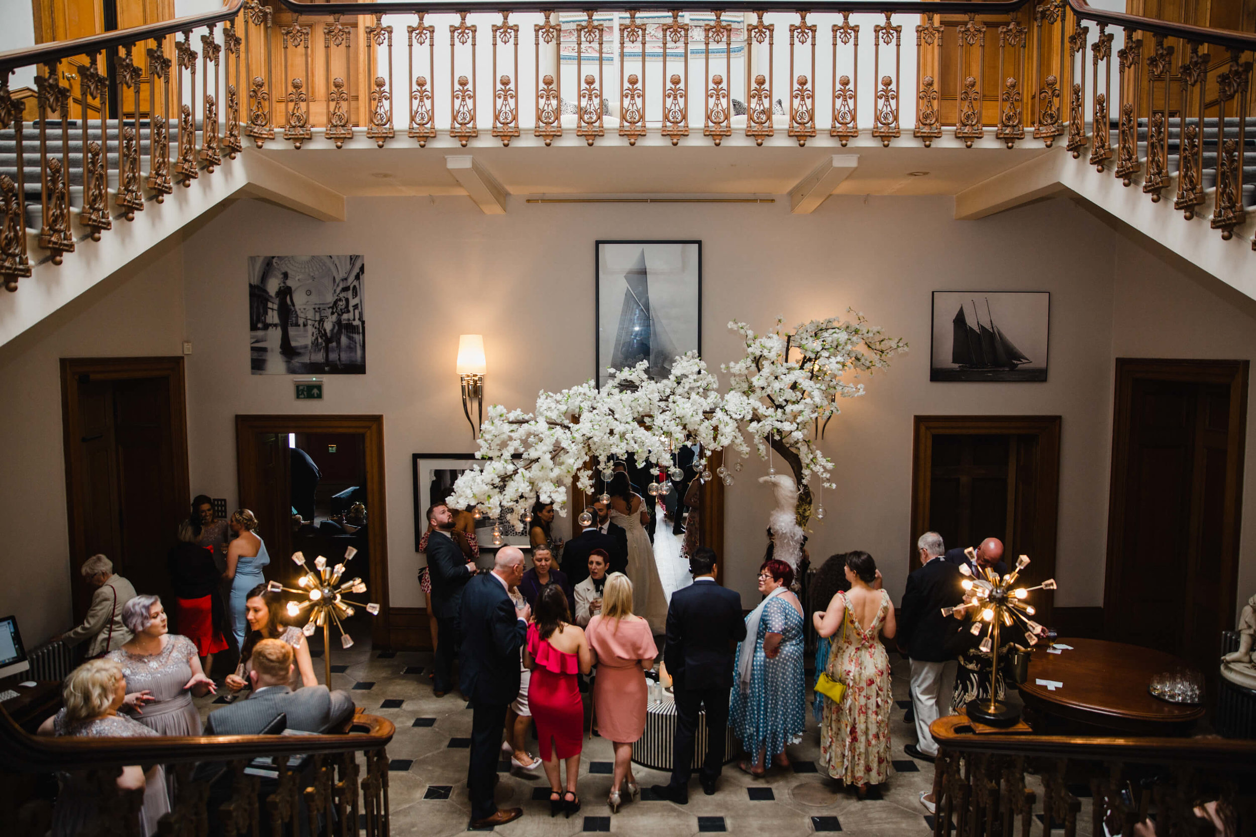 wide angle drinks reception photograph under staircase at haigh hall