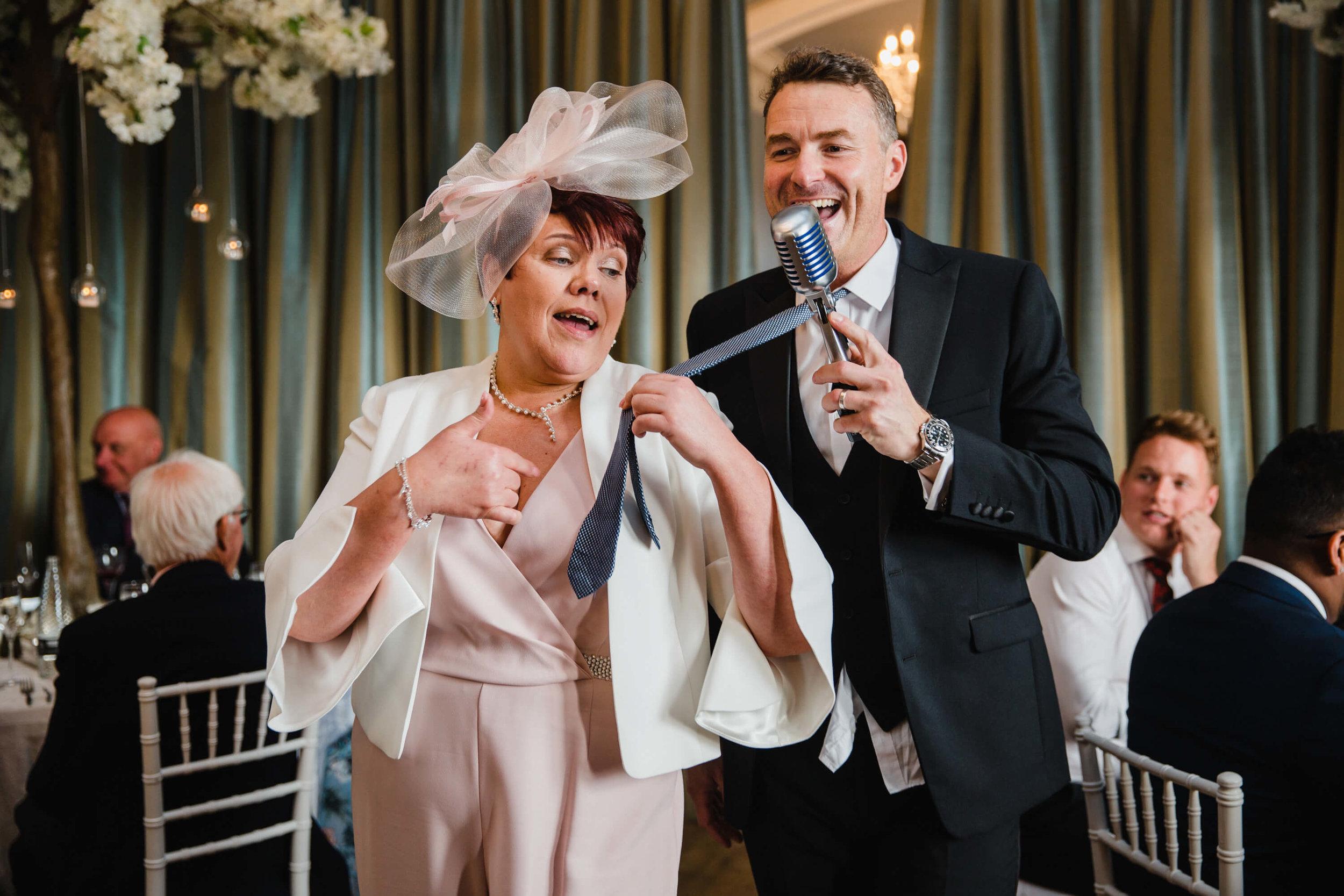 mother of bride pulling howard wing wedding singer by tie