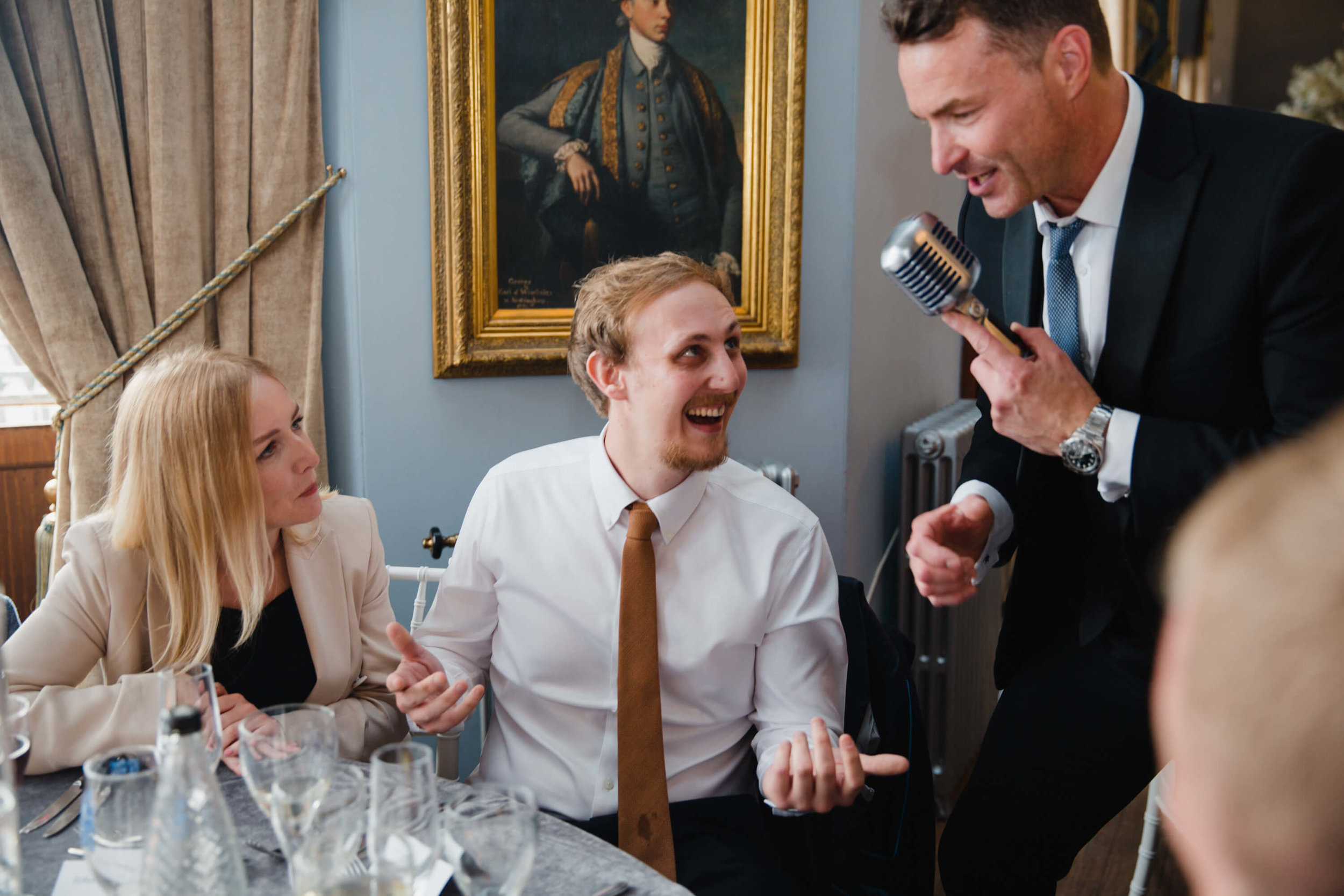 wedding guest singing into microphone during entertainment