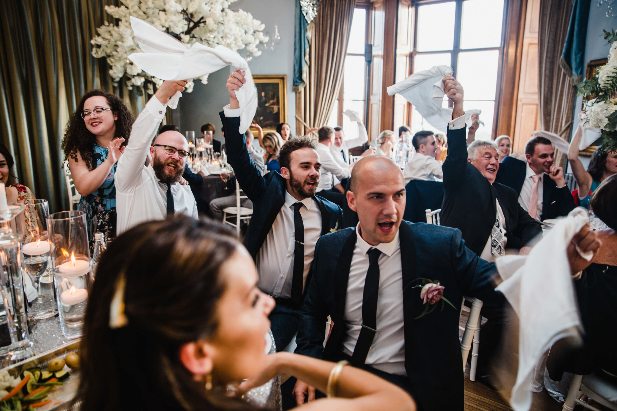groomsmen waving handkerchiefs while singing