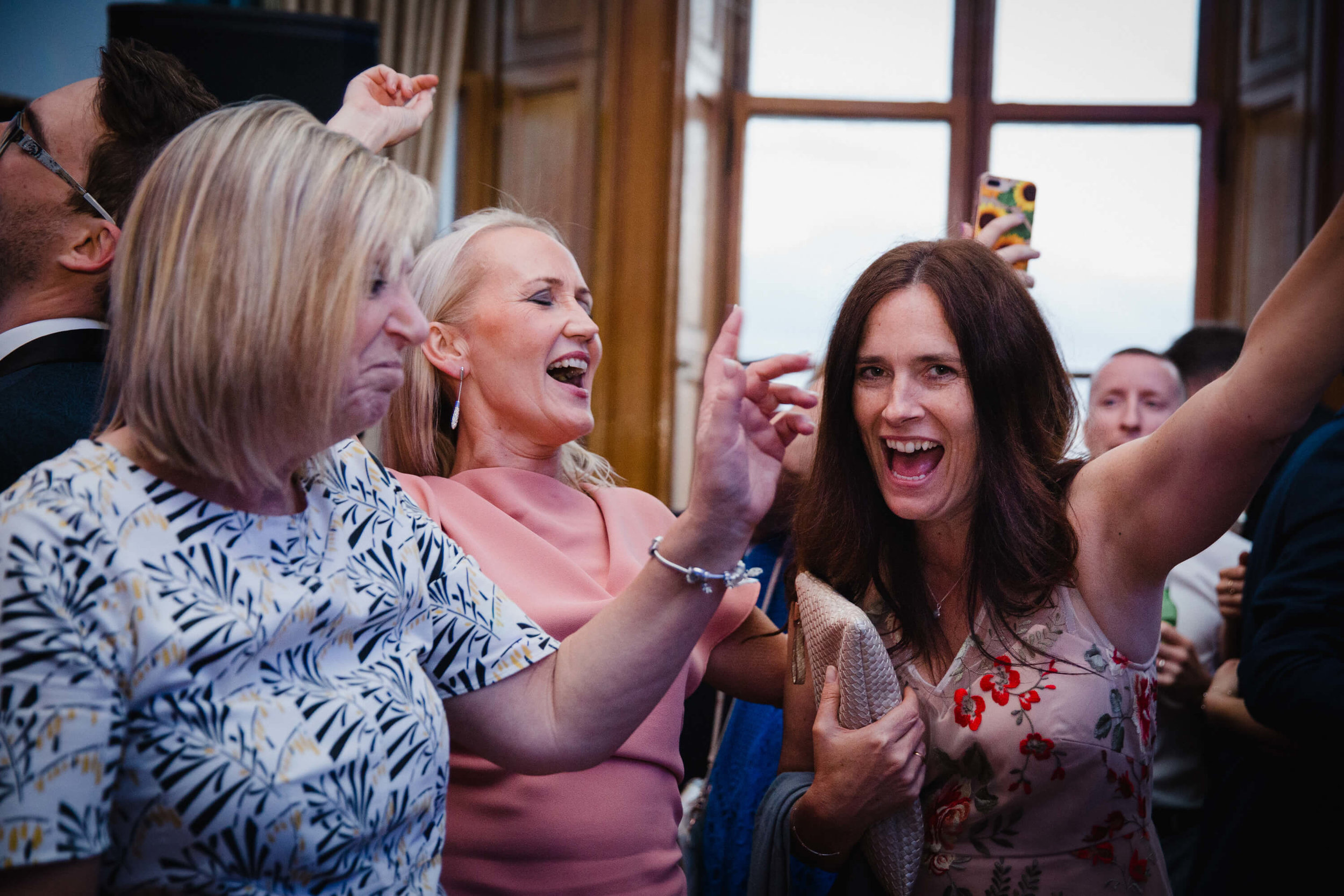 wedding guests dance and party to music at haigh hall