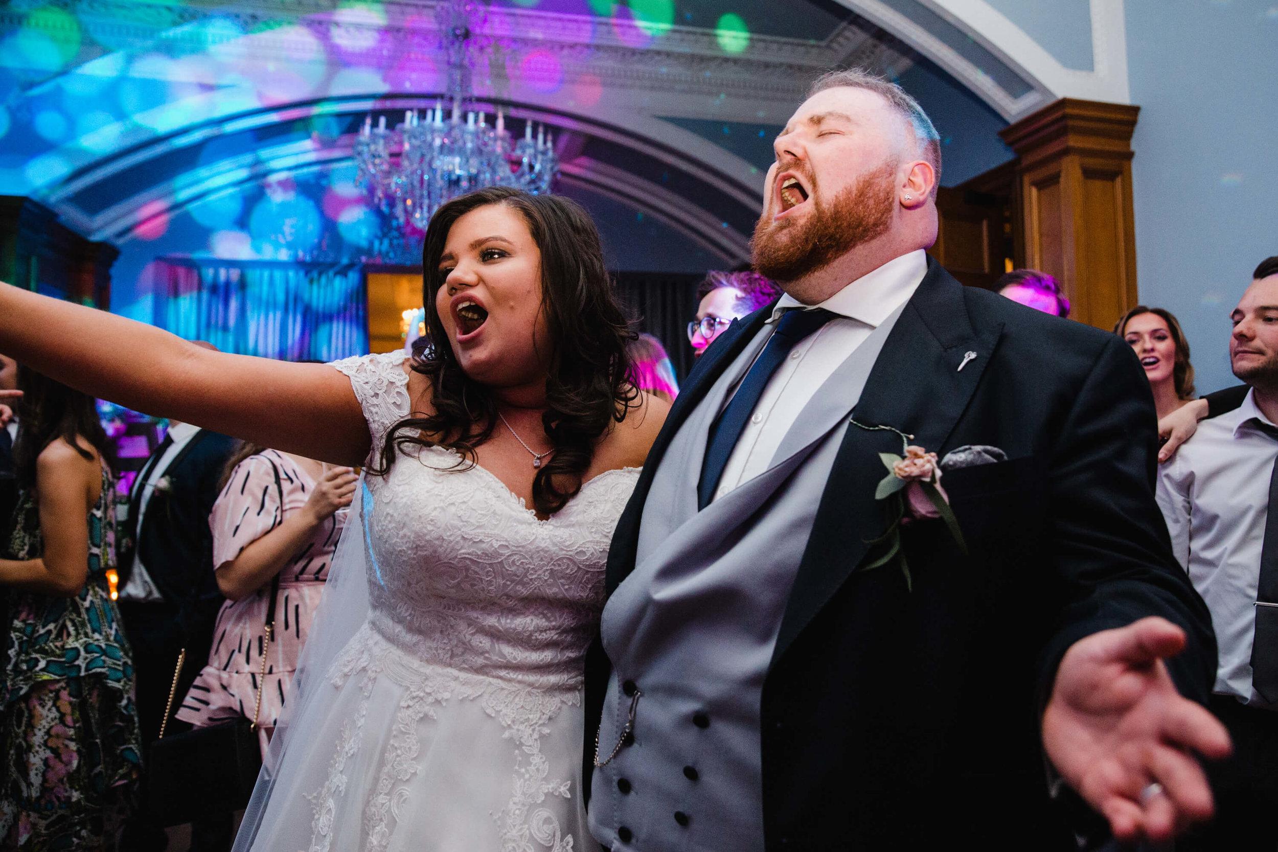 newlyweds celebrate on dancefloor at haigh hall