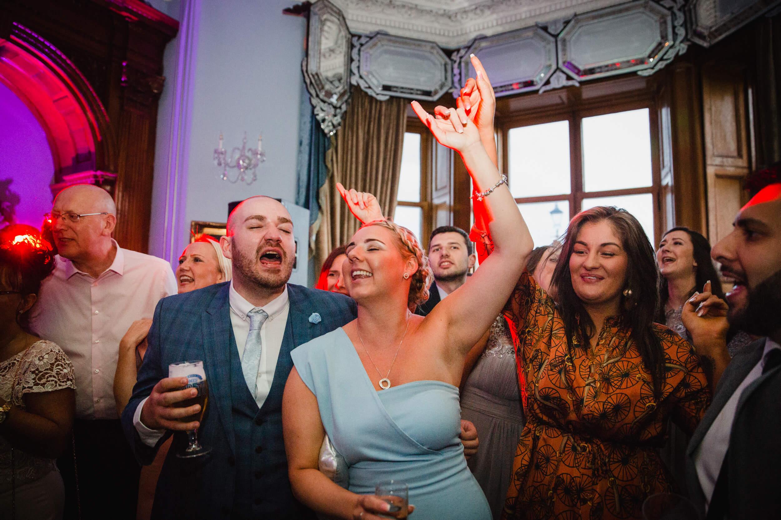 wedding guests partying on dance floor