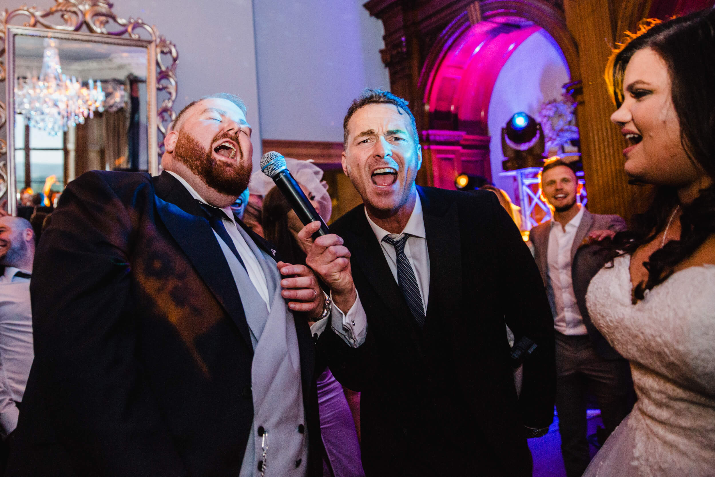 groom partying with bride at end of wedding