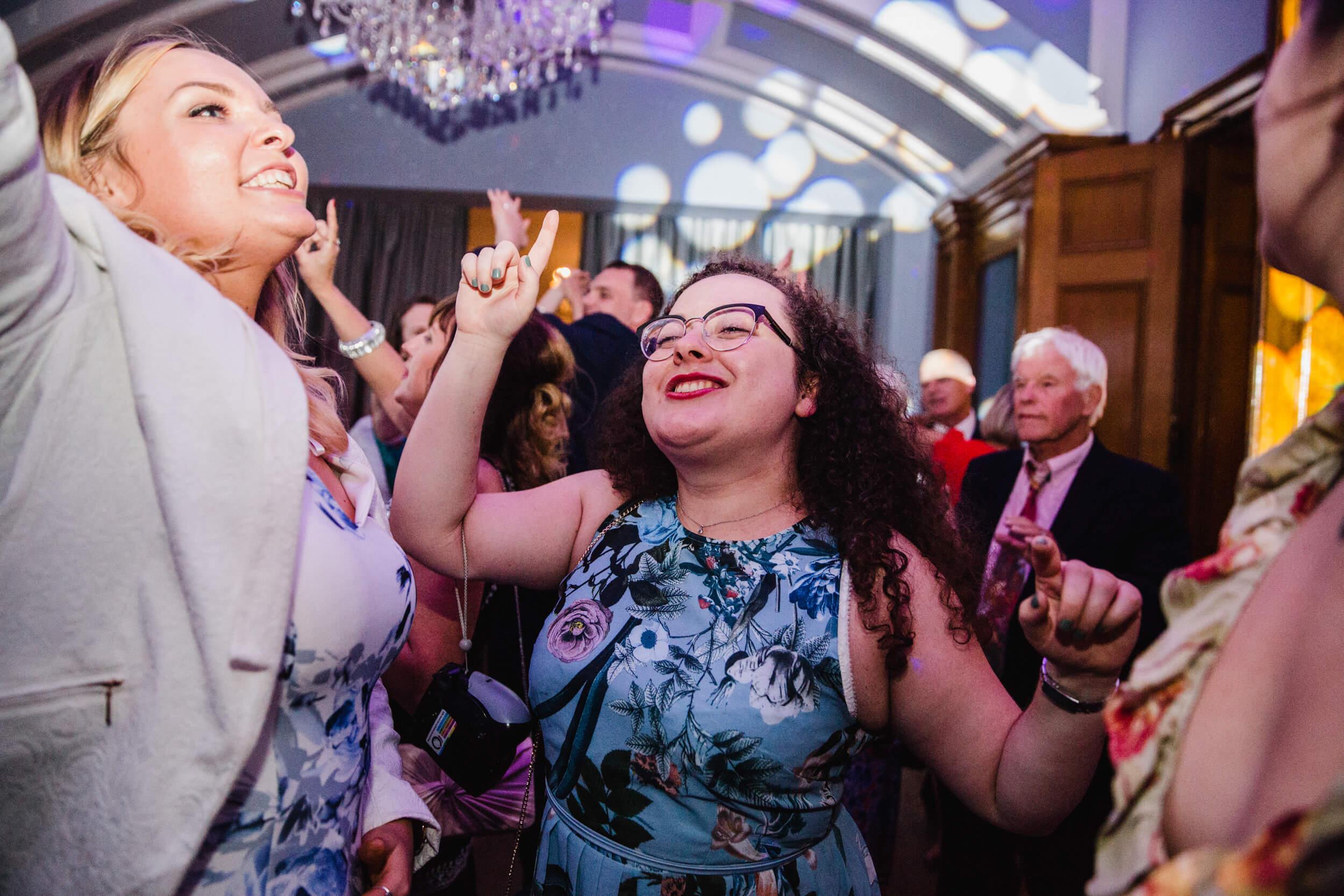 bridesmaid dancing with guests at haigh hall
