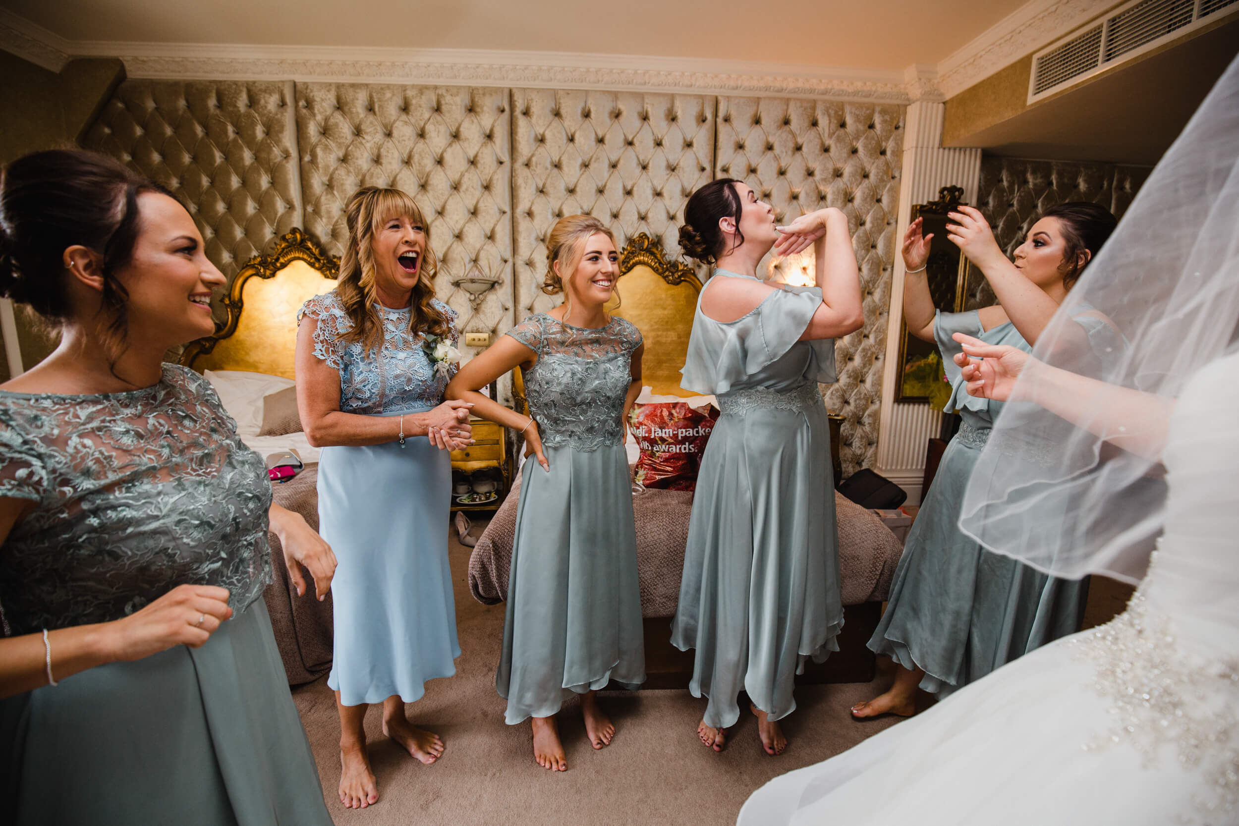 emotional reactions of bridesmaids to bride in dress