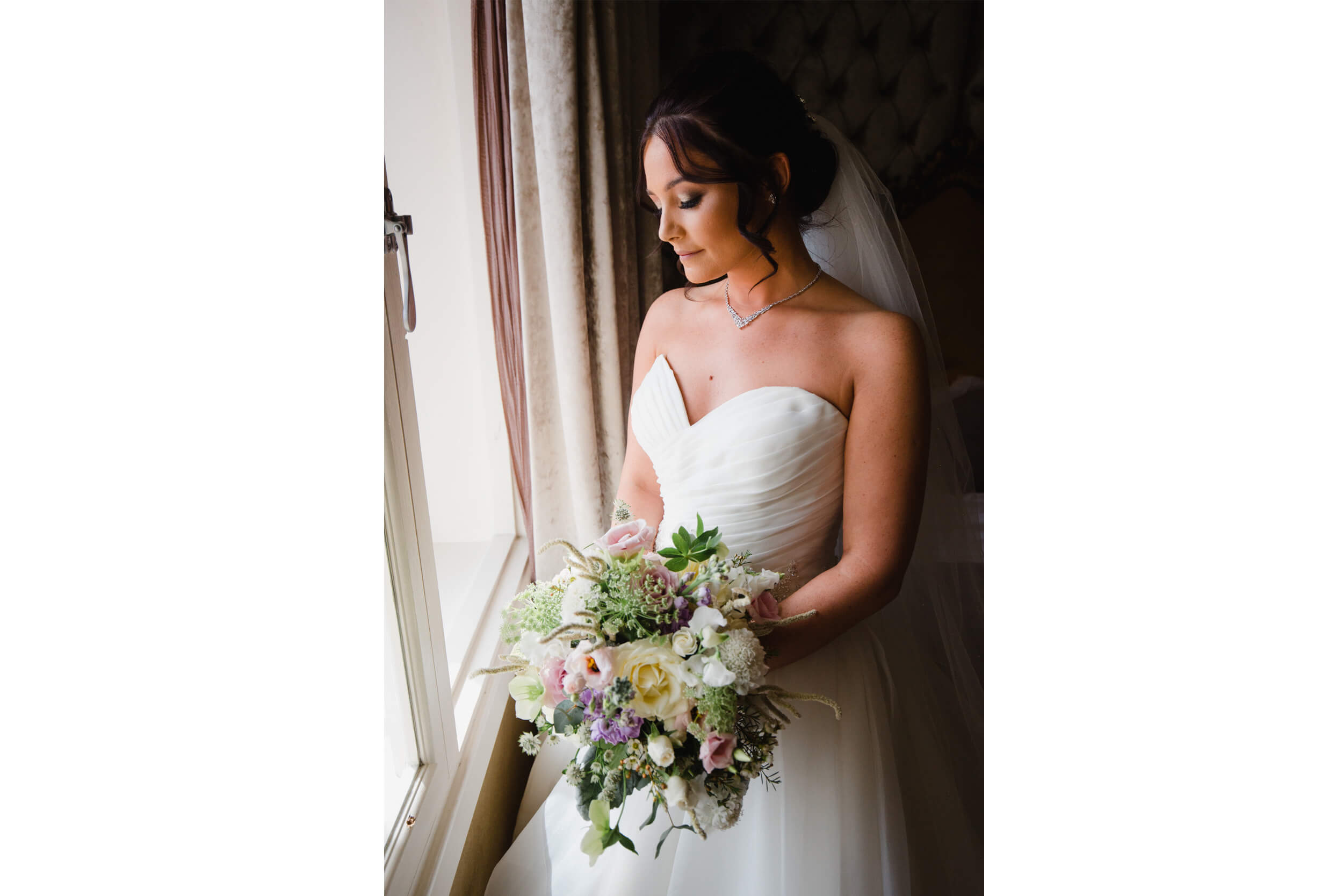 portrait photograph of bride holding bouquet by the window for her 30 james street wedding