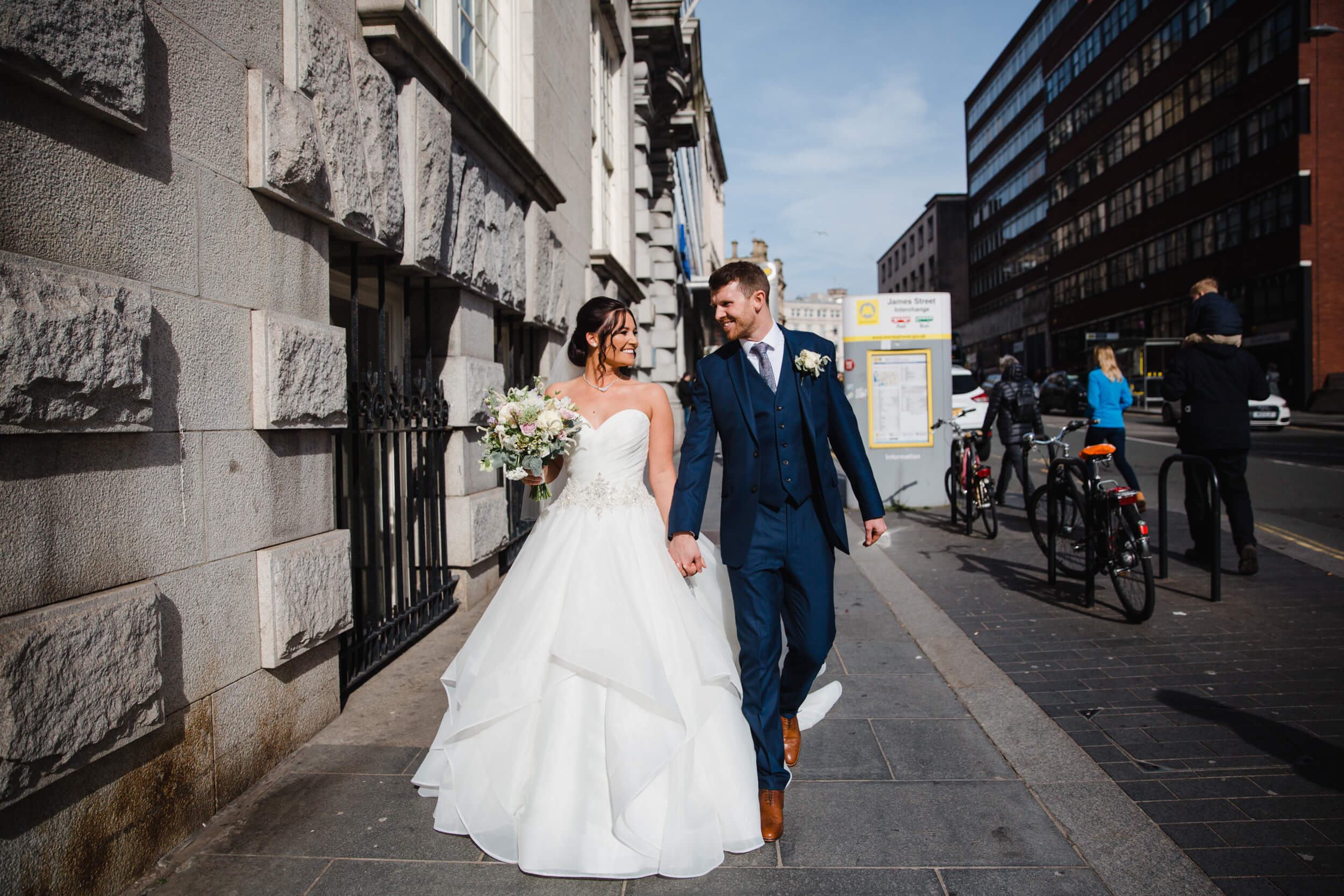 newly wedded couple streetwalking for natural portraits