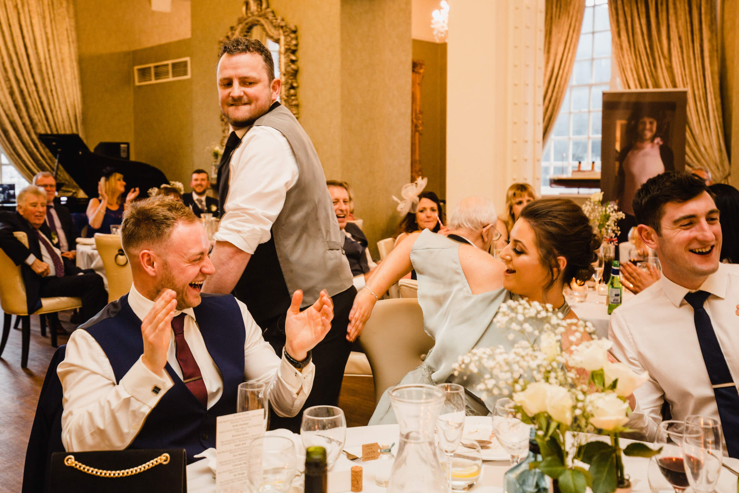 bridesmaid and guests having fun with silver service singing waiters