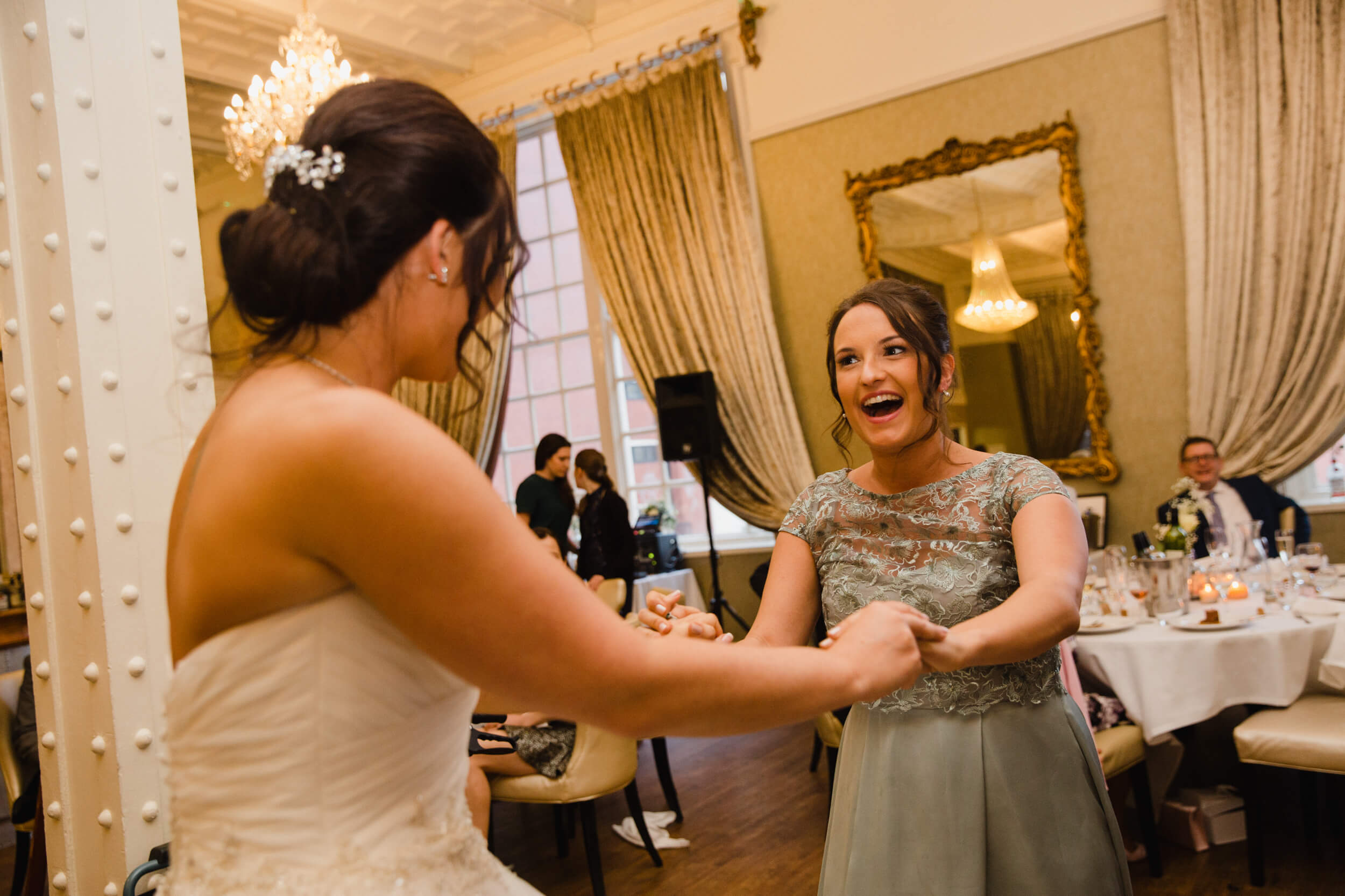 bridesmaid dancing with bride at 30 James Street Hotel