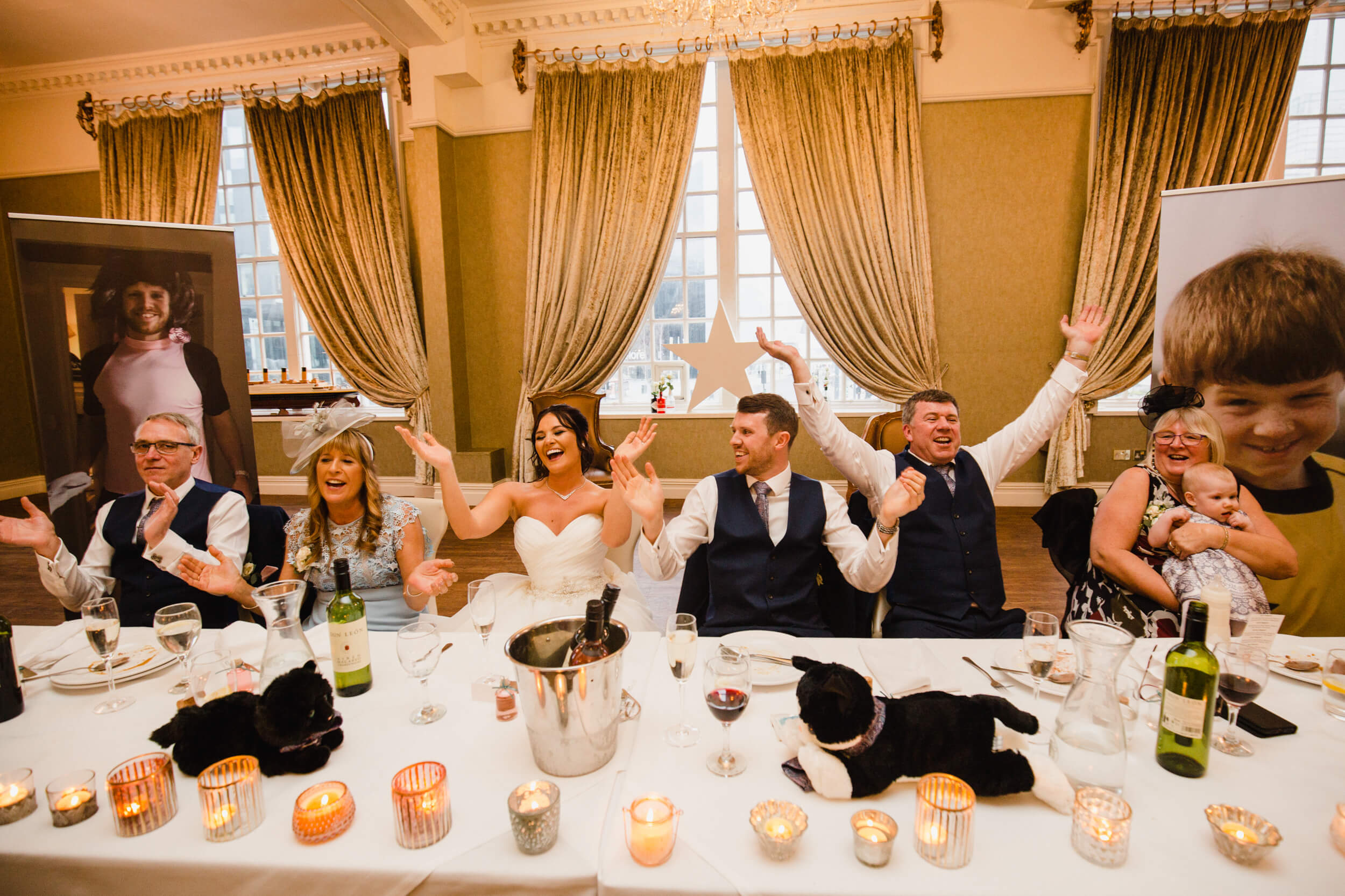 wide angle lens photograph of top table dancing to singing waiters music
