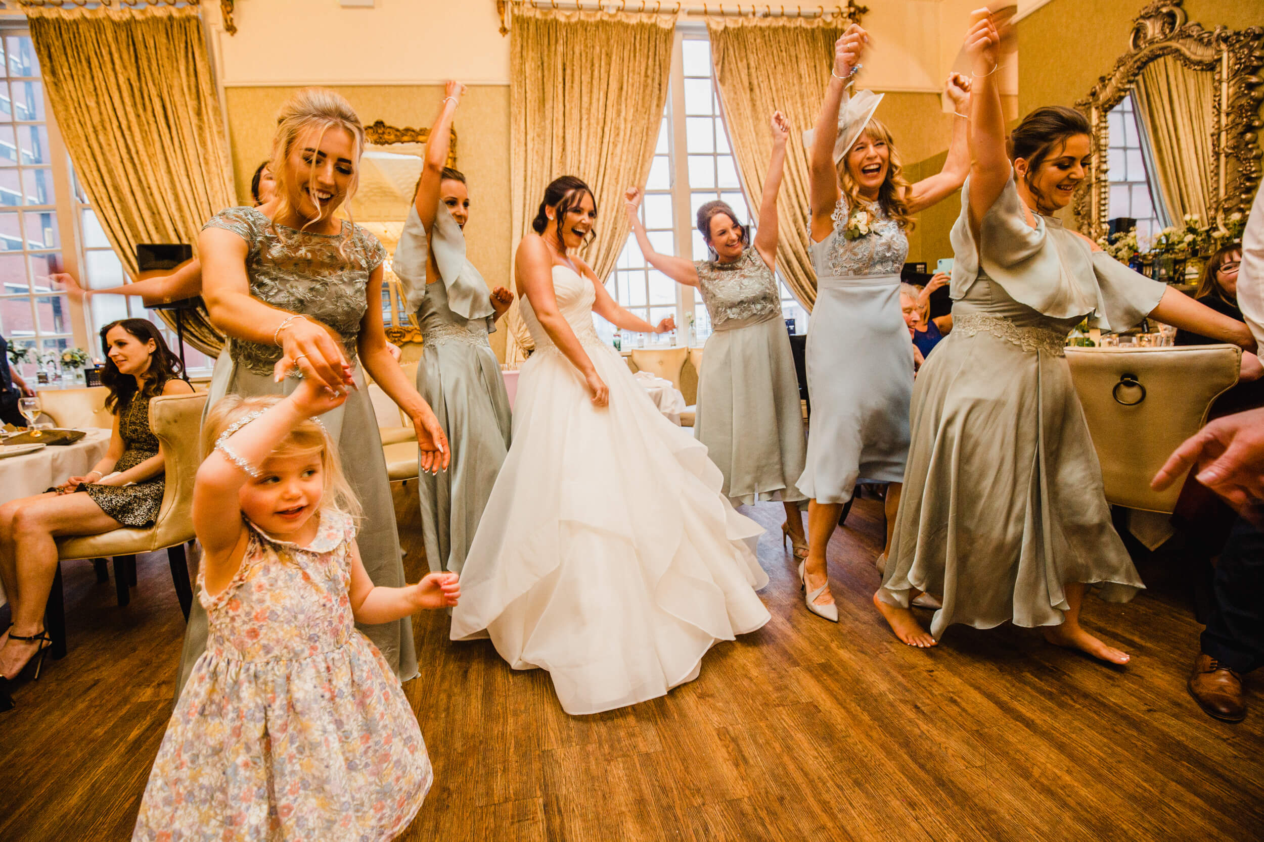 bride dancing with all bridesmaids together at 30 James Street Hotel