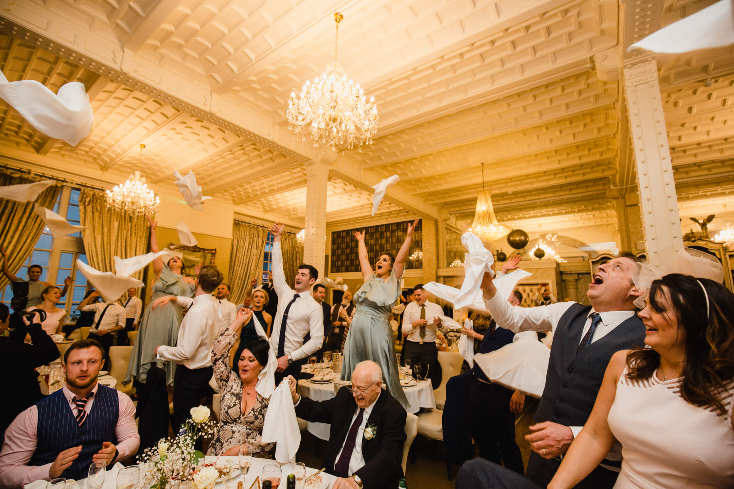 bridal party and groomsmen all throwing napkins in the air at 30 James Street Hotel