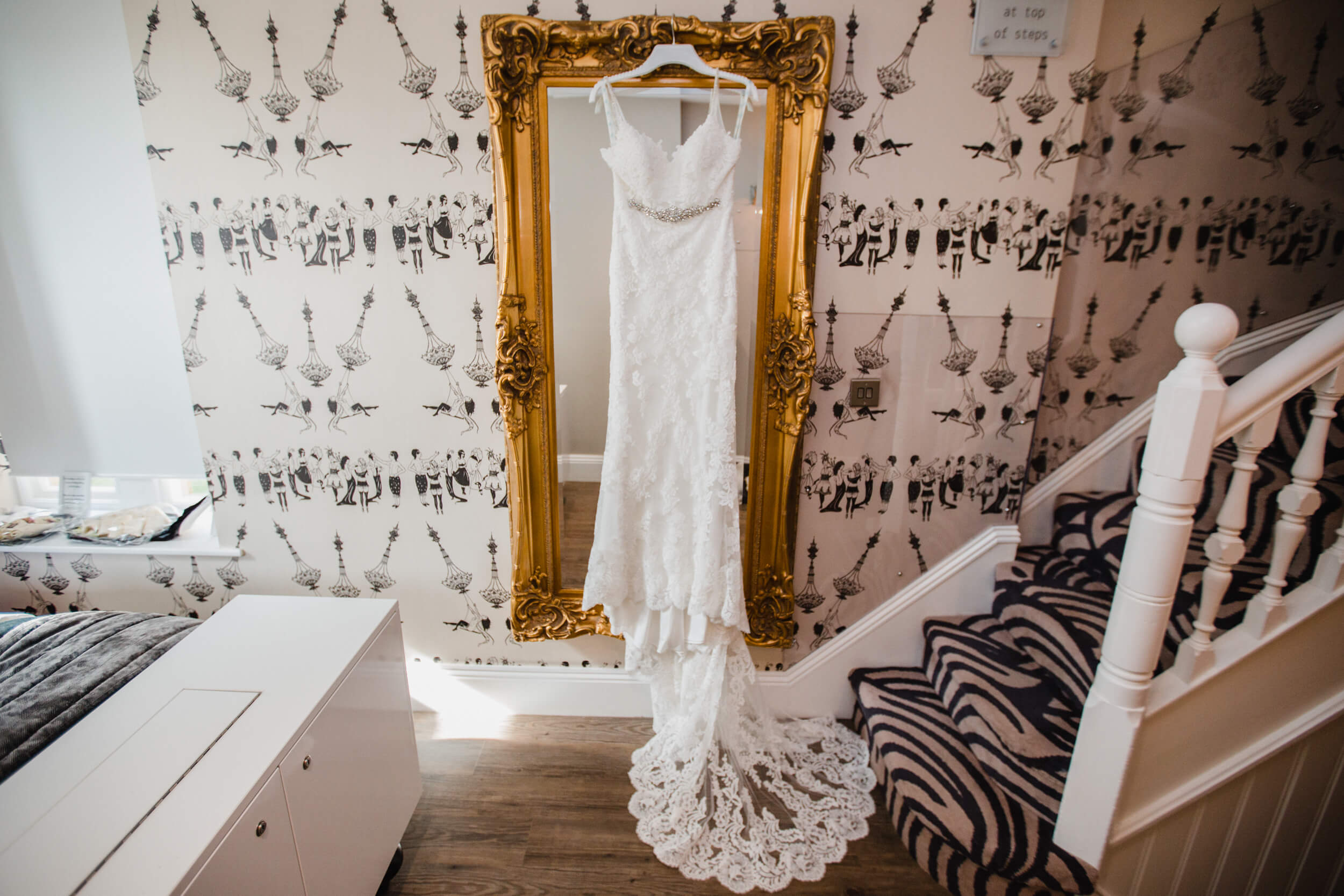 wedding dress hung up on mirror at oddfellows on the park