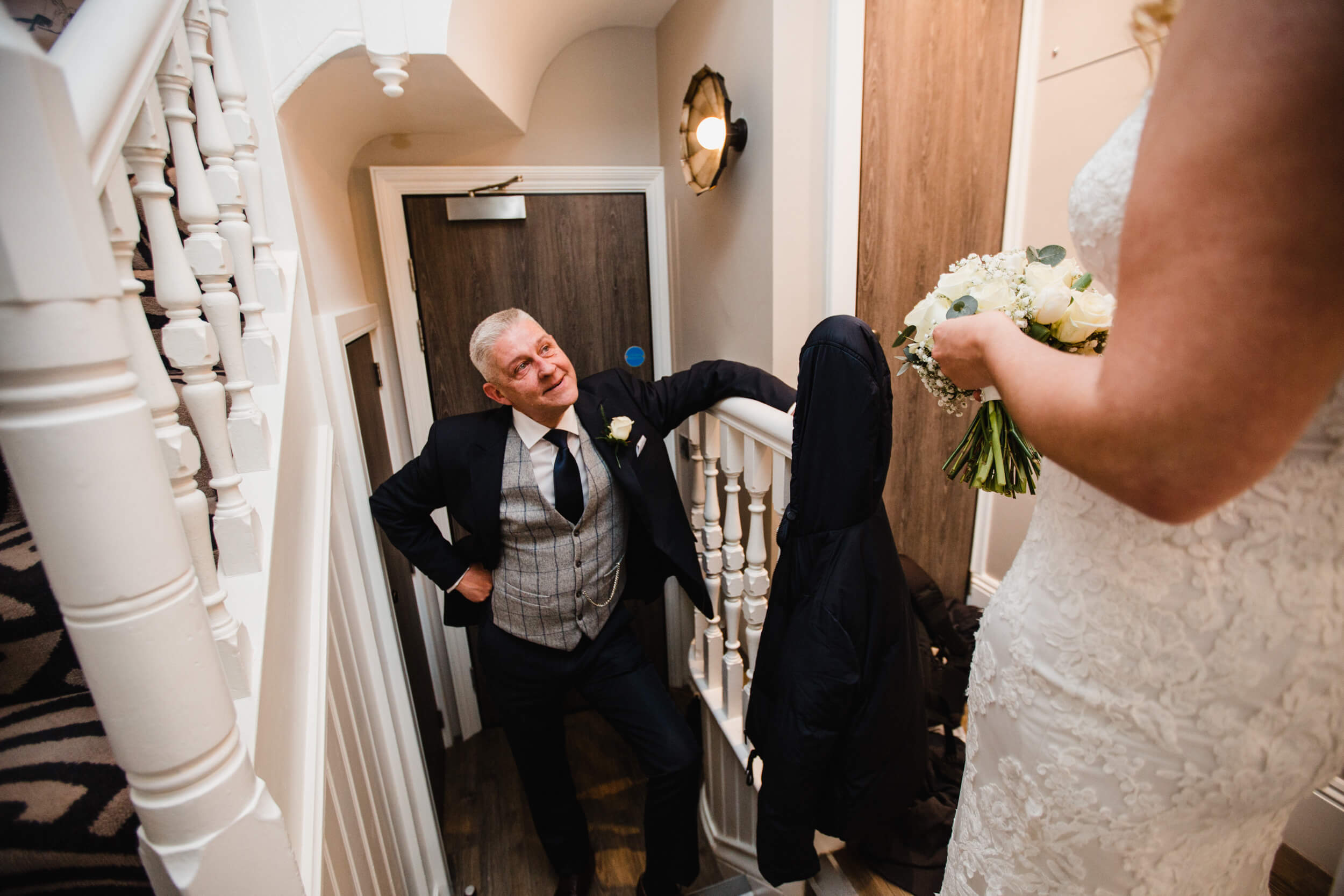 first look photograph of father with bride in wedding dress