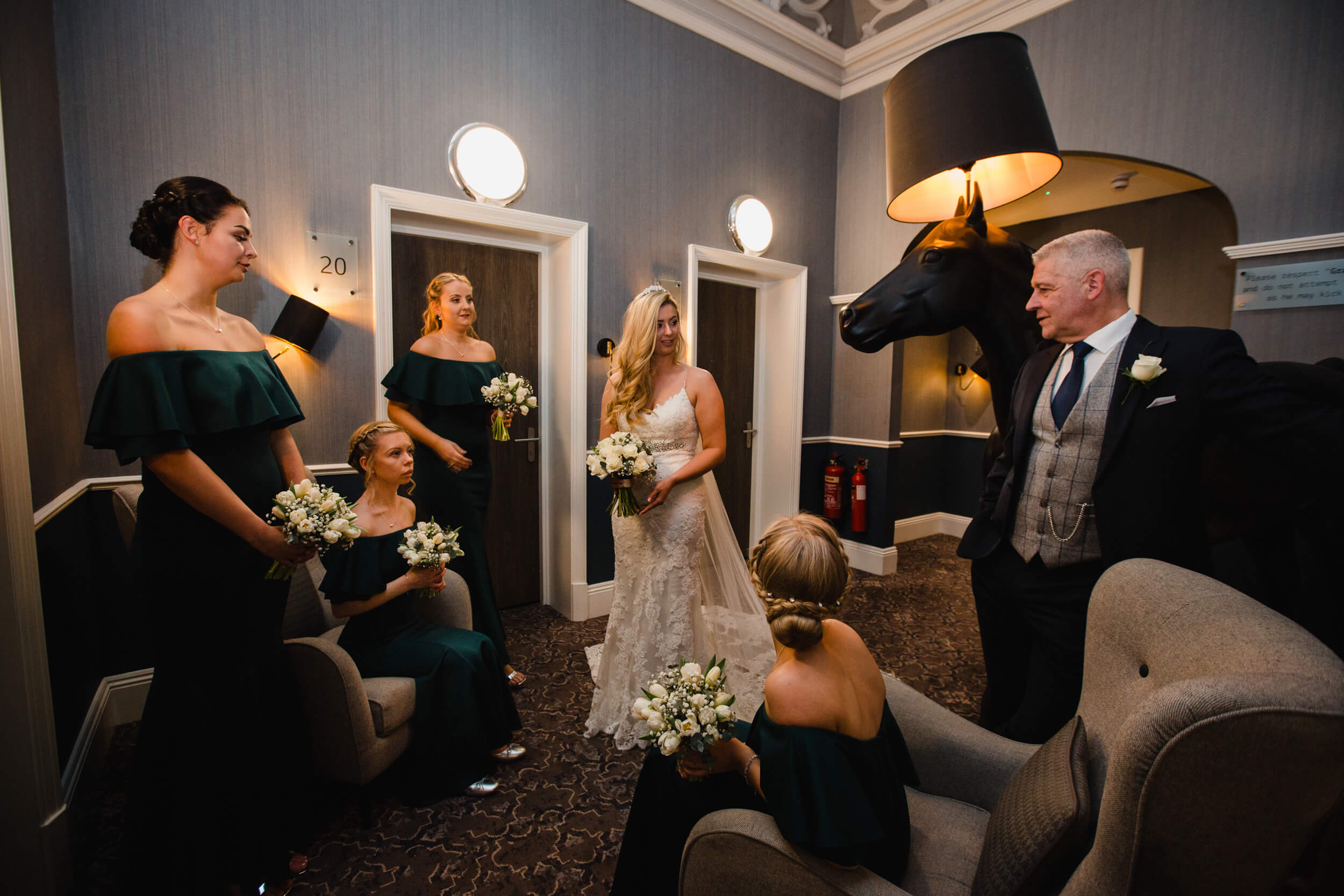 bridal party holding bouquets in hallway at oddfellows on the park