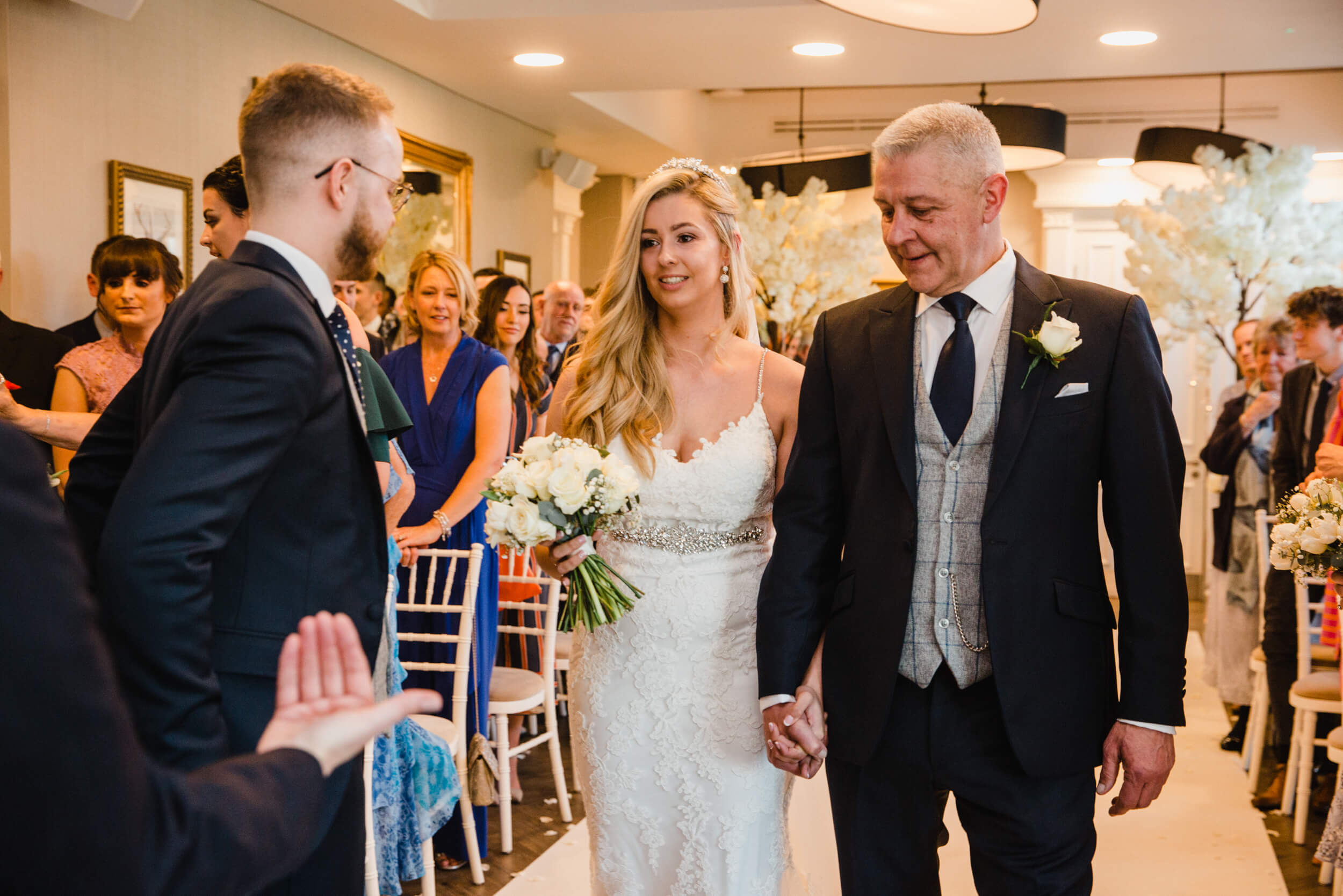 groom greets bride at top of aisle at oddfellows on the park