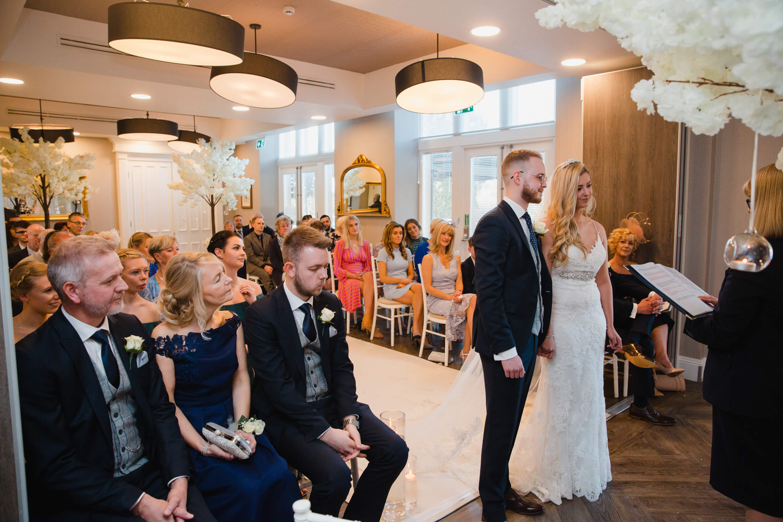 wide angle lens photograph of wedded couple holding hands at oddfellows on the park