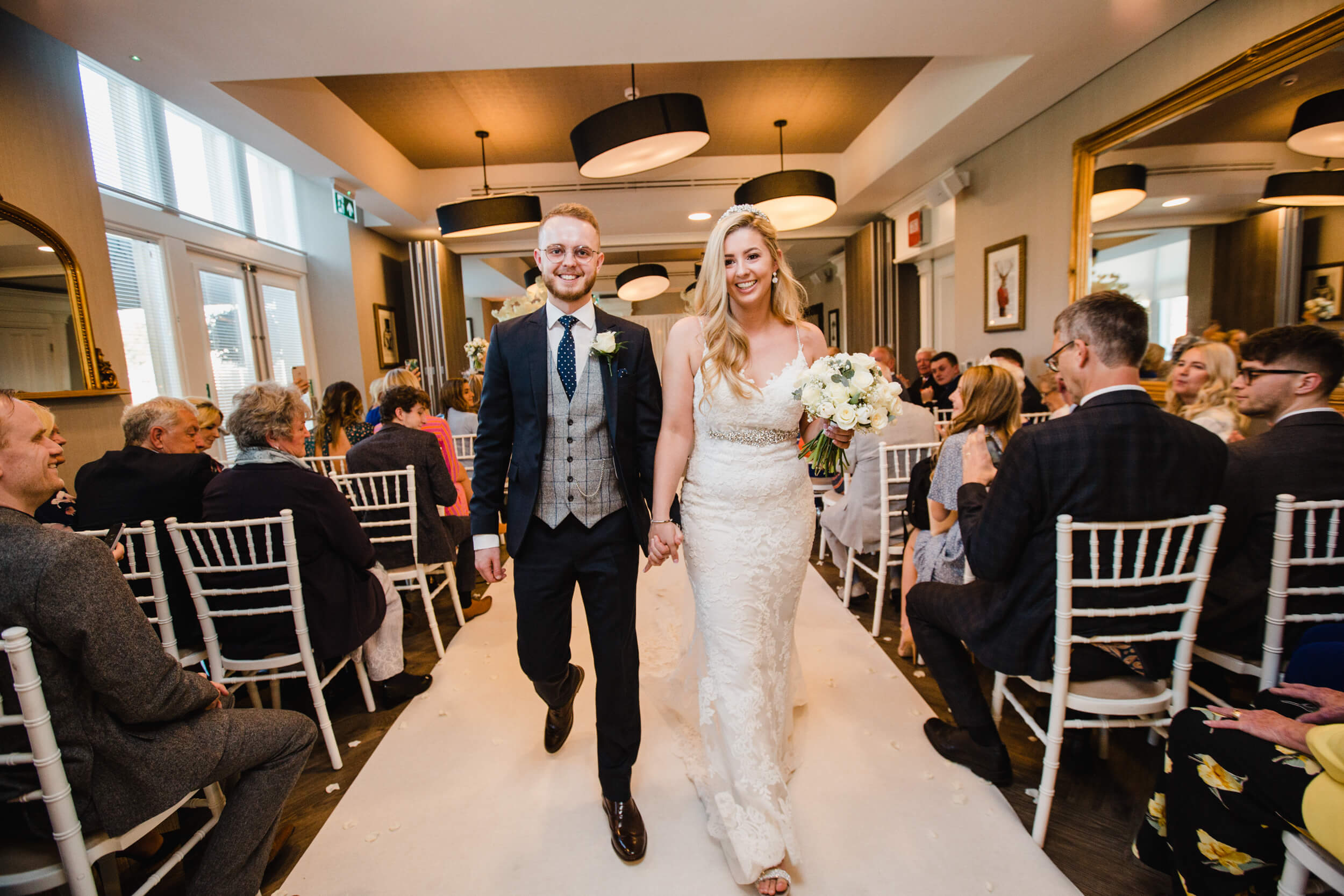 newlyweds happily married walking towards camera at oddfellows on the park
