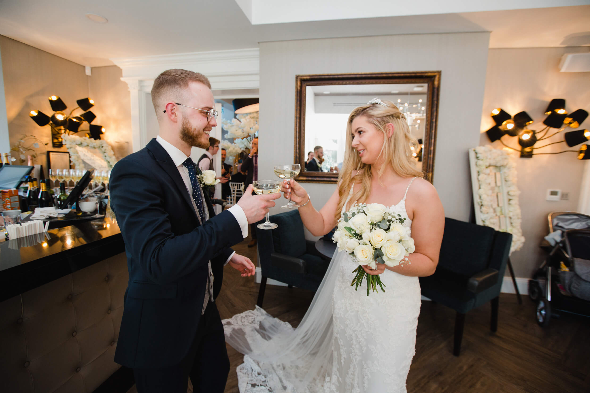 newlyweds celebrating with glasses of champagne