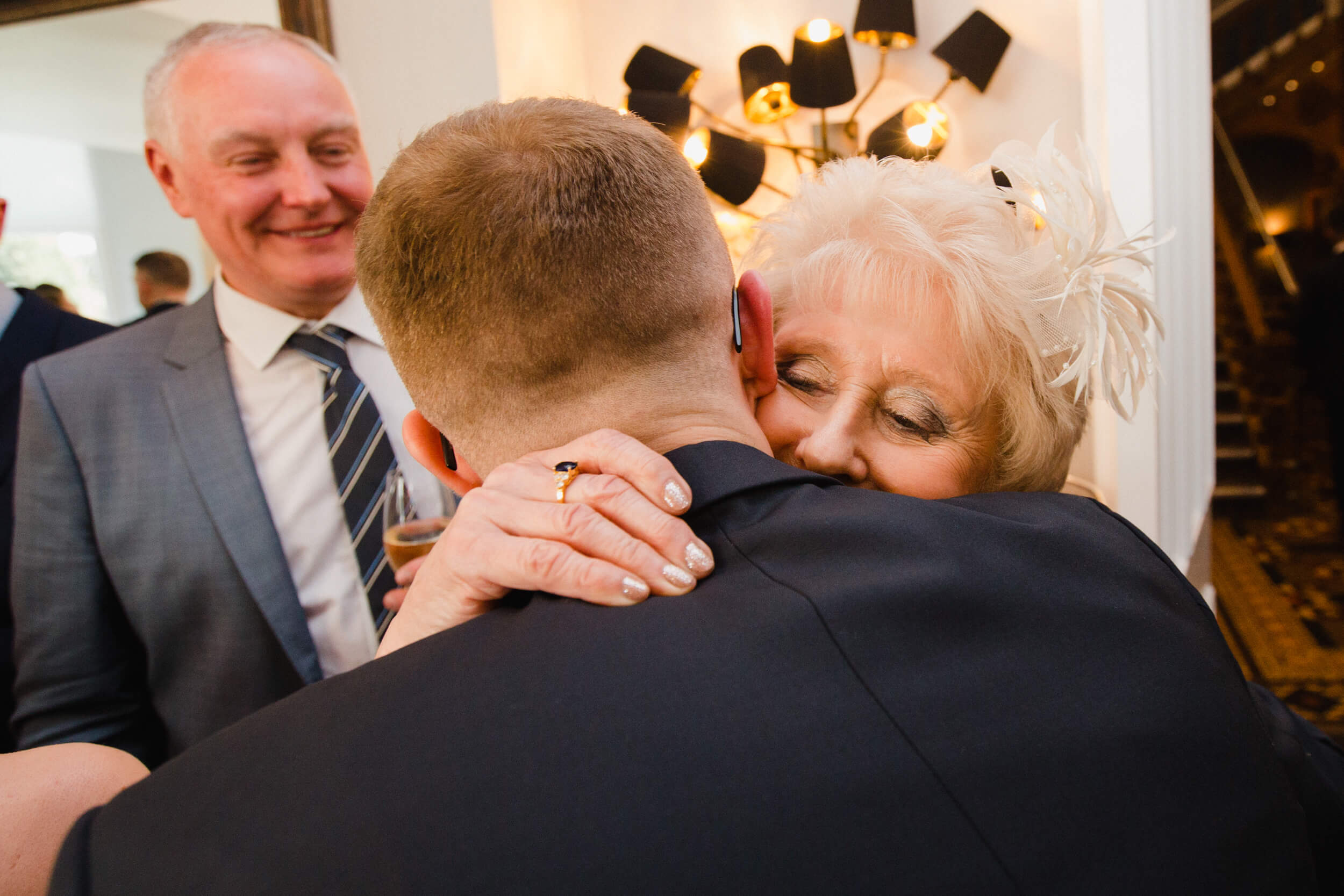grandmother hugs and shares intimate moment with groom