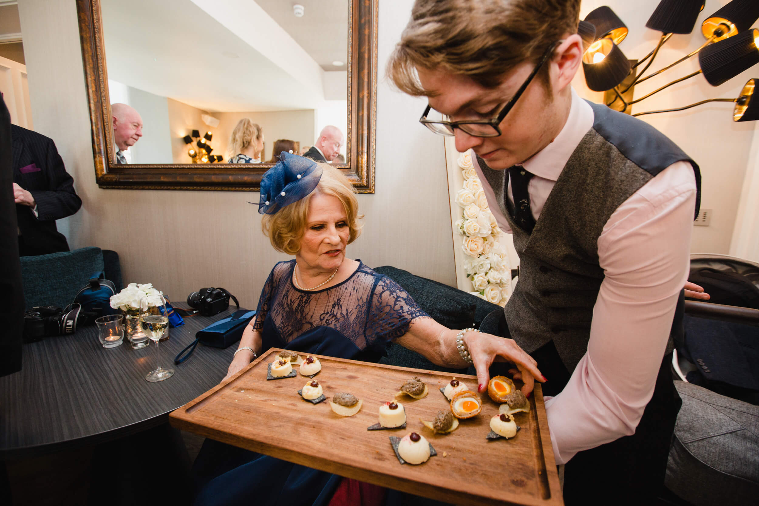 wedding guest reaches out for canapé
