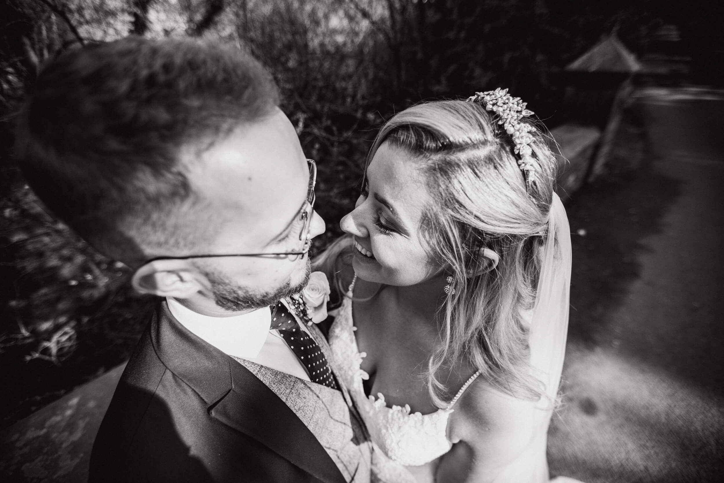 black and white intimate photograph of bride and groom