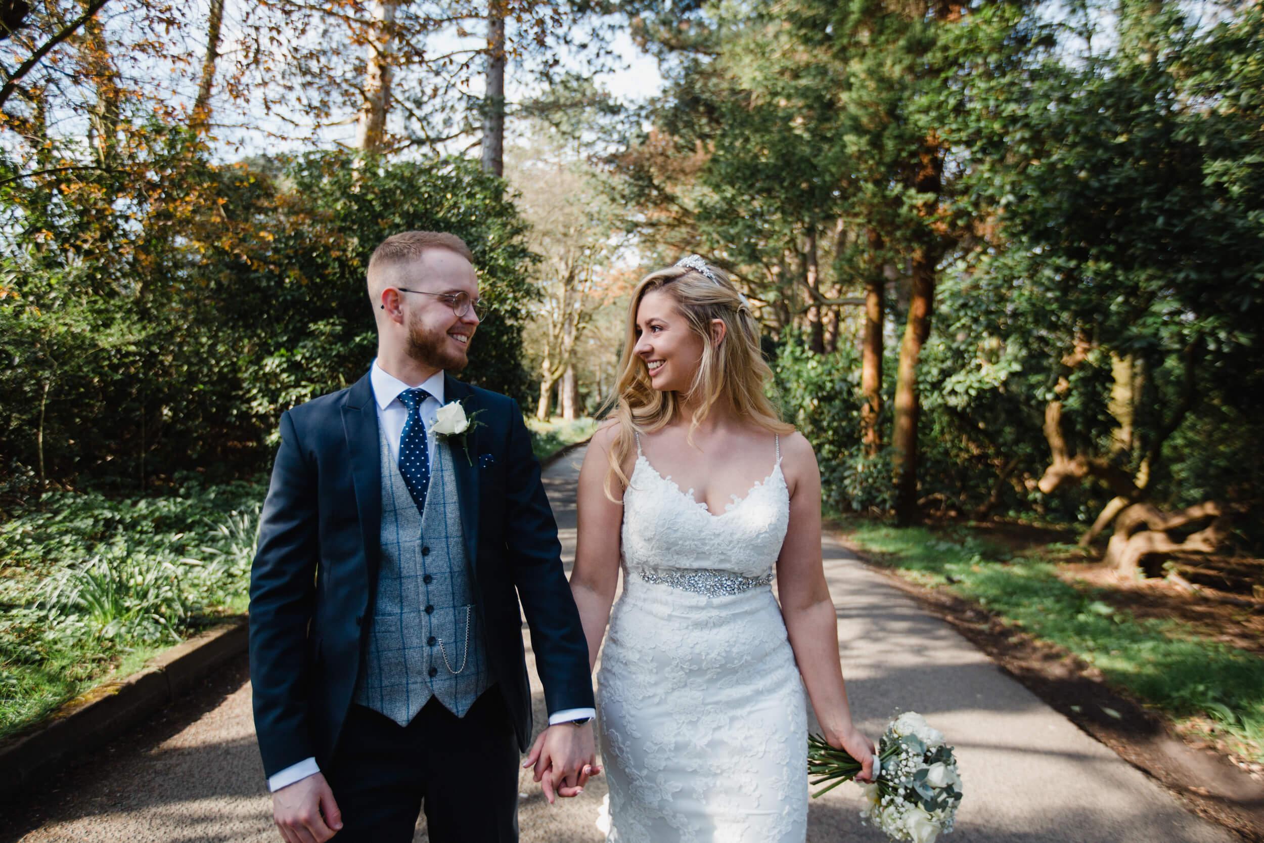 newly married couple walking towards carpark