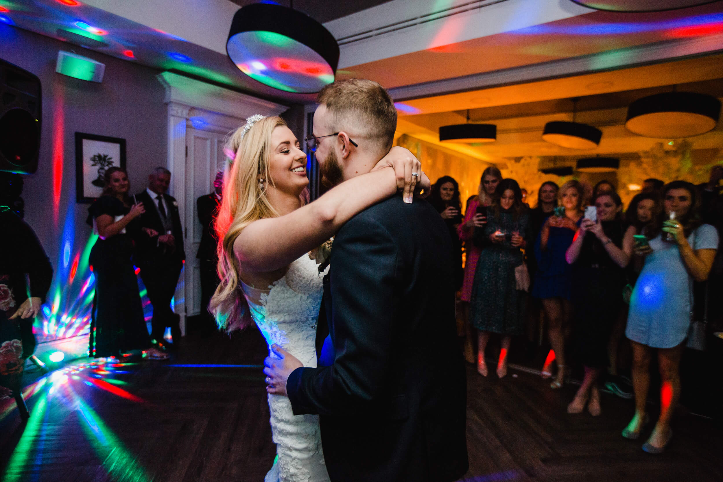 close up photograph of bride holding groom during first dance