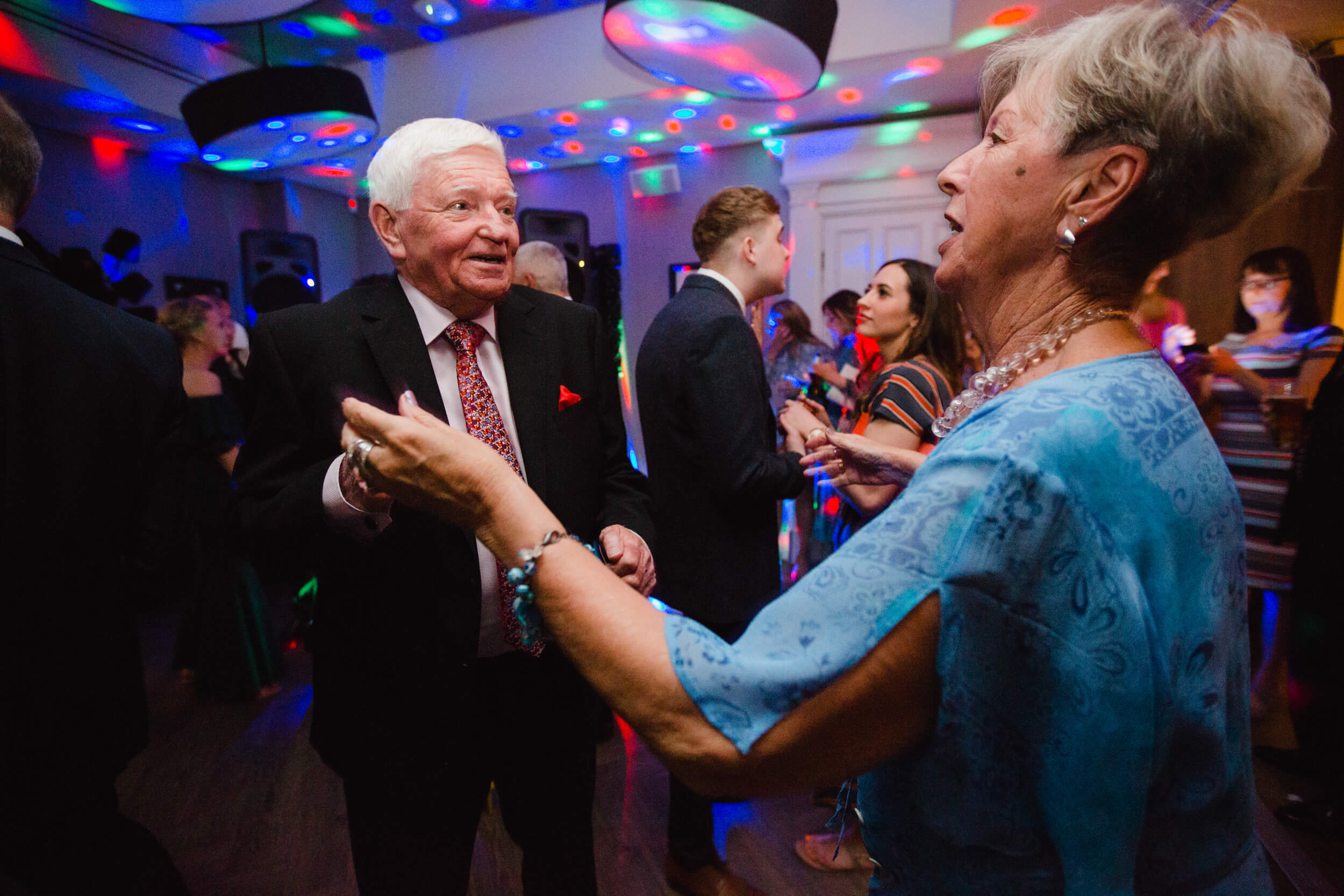 grandparents dancing together on dance floor at end of night