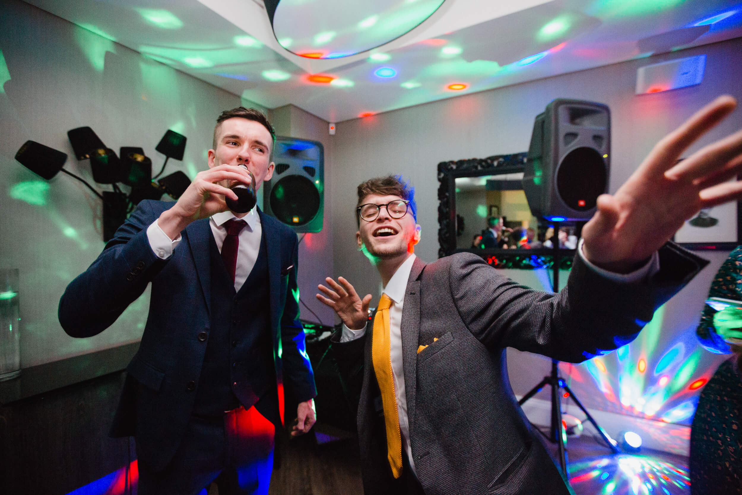 wedding guests dancing into the camera at oddfellows on the park