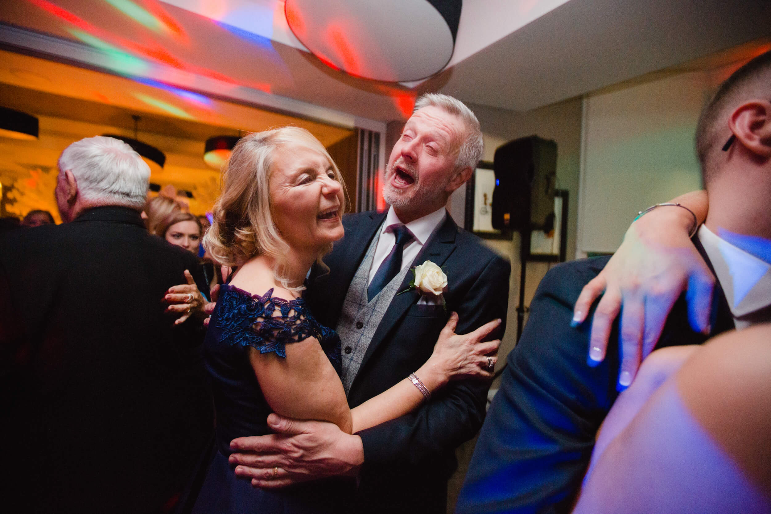 mother and father of groom dancing after first dance