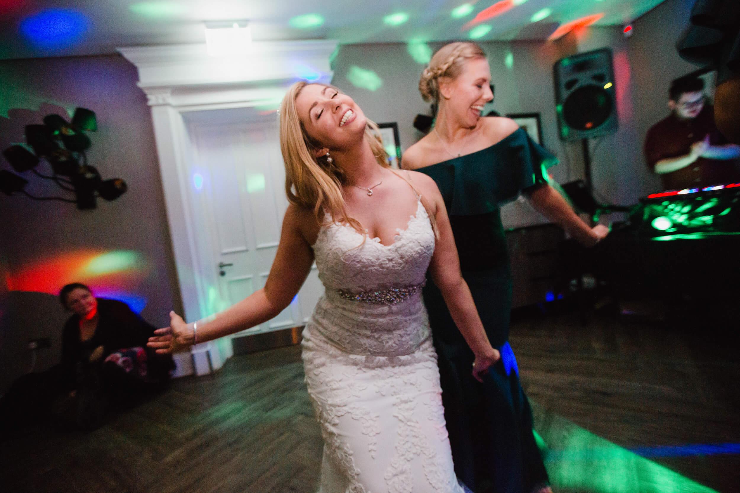 bride dancing with friends on dancefloor
