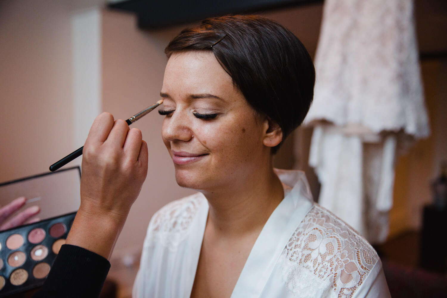 close up macro lens photograph of bride having make up applied in window at great john street hotel
