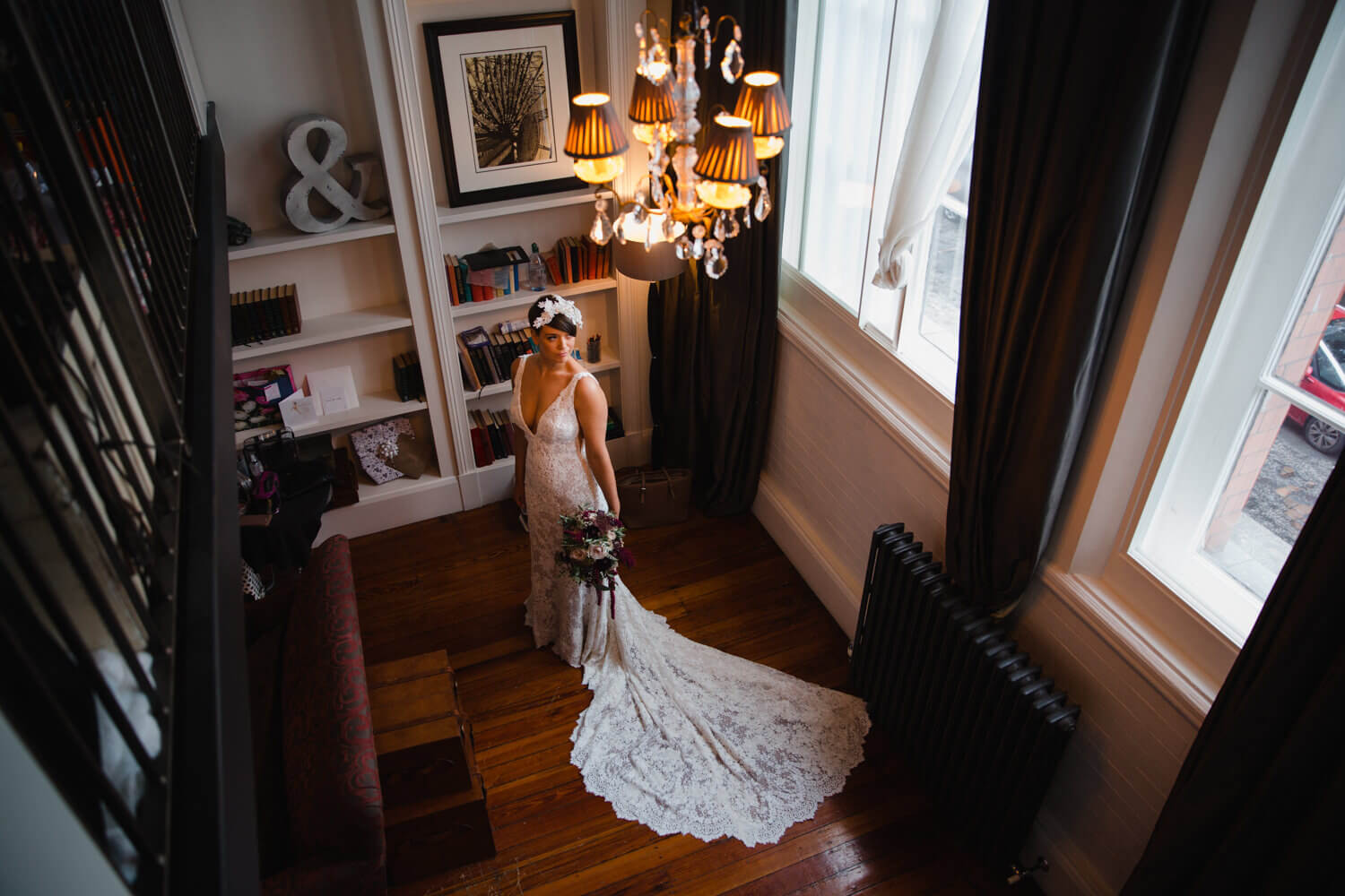wide angle lens portrait of bride in wedding dress posing with bouquet of flowers at great john street hotel