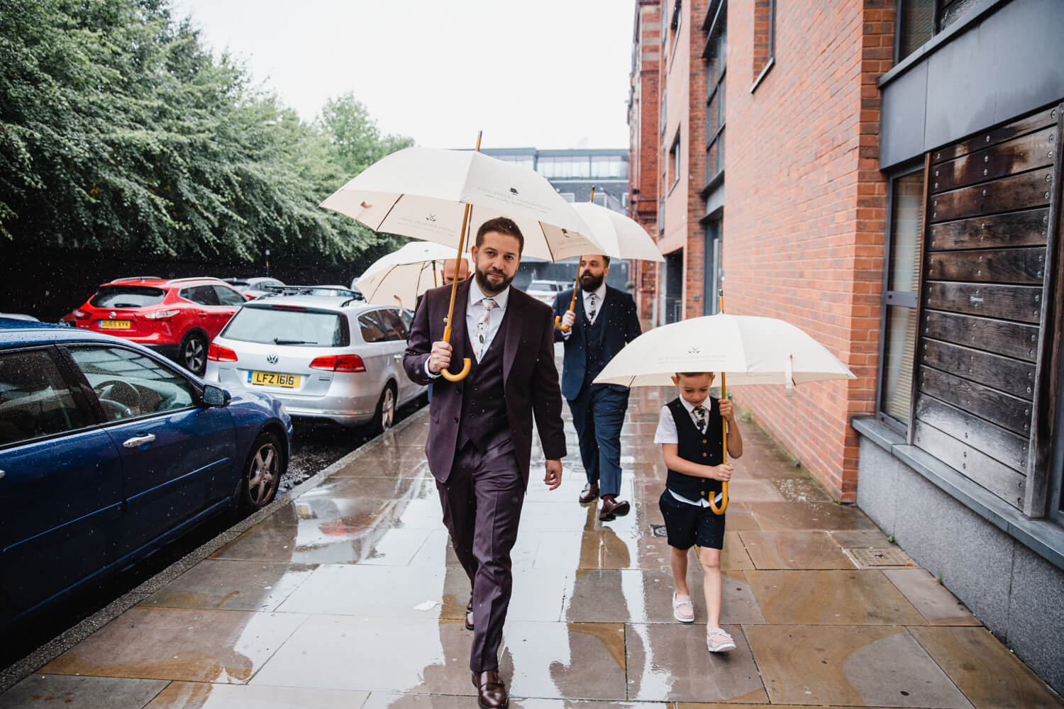 groom making his way to the ceremony with page boy