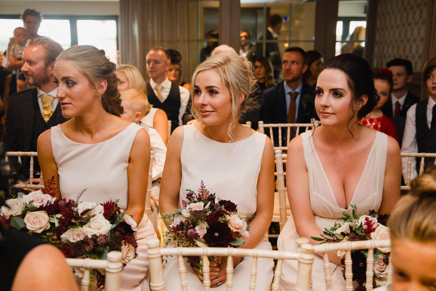 bridesmaids holding bouquets during wedding service