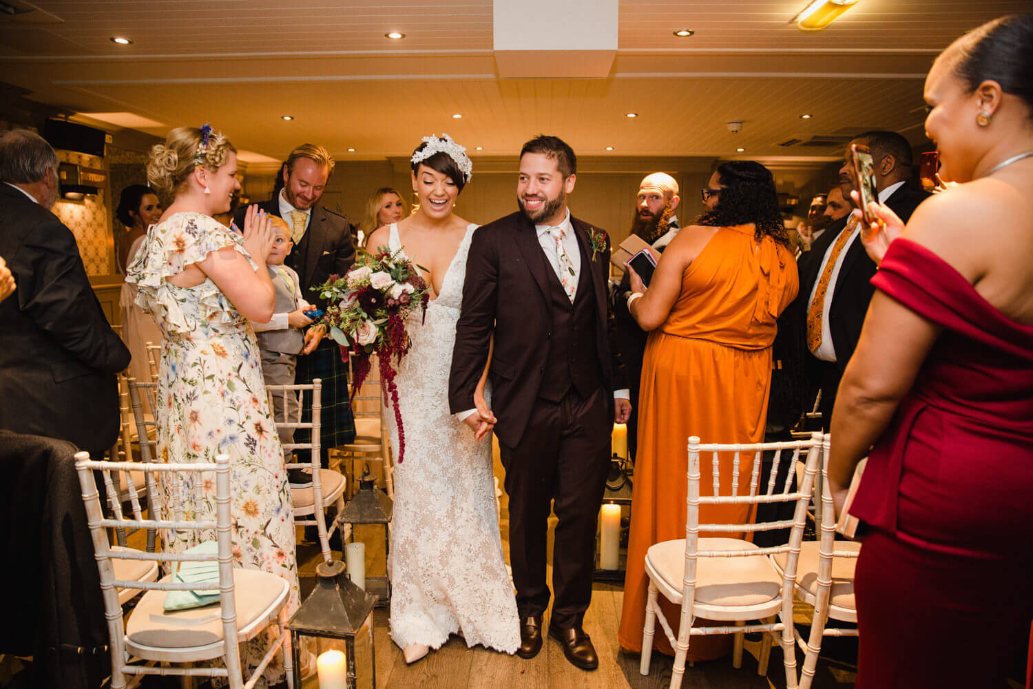 newly married couple being cheered by wedding party during processional at great john street hotel