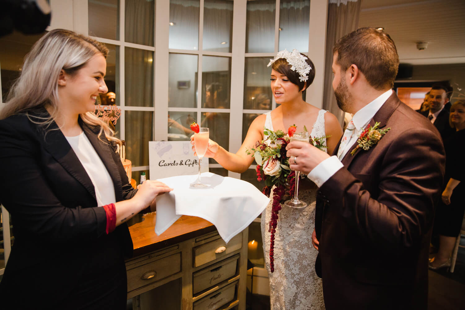 newlyweds share glass of champagne as celebration to wedding