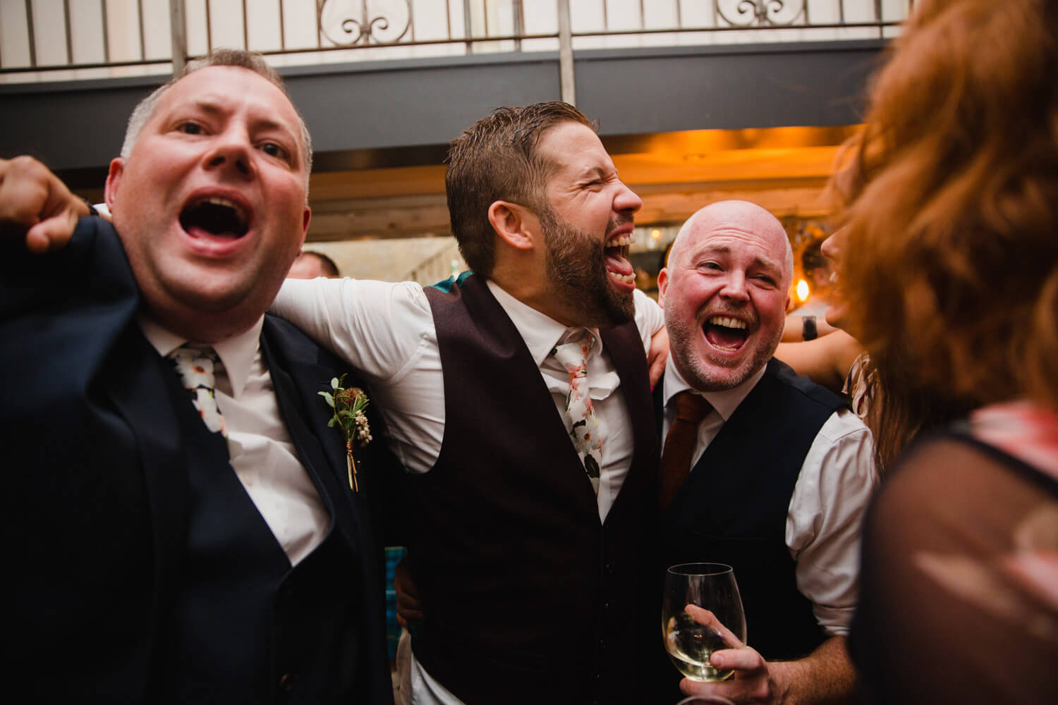groom partying with groomsmen and friends at end of the night