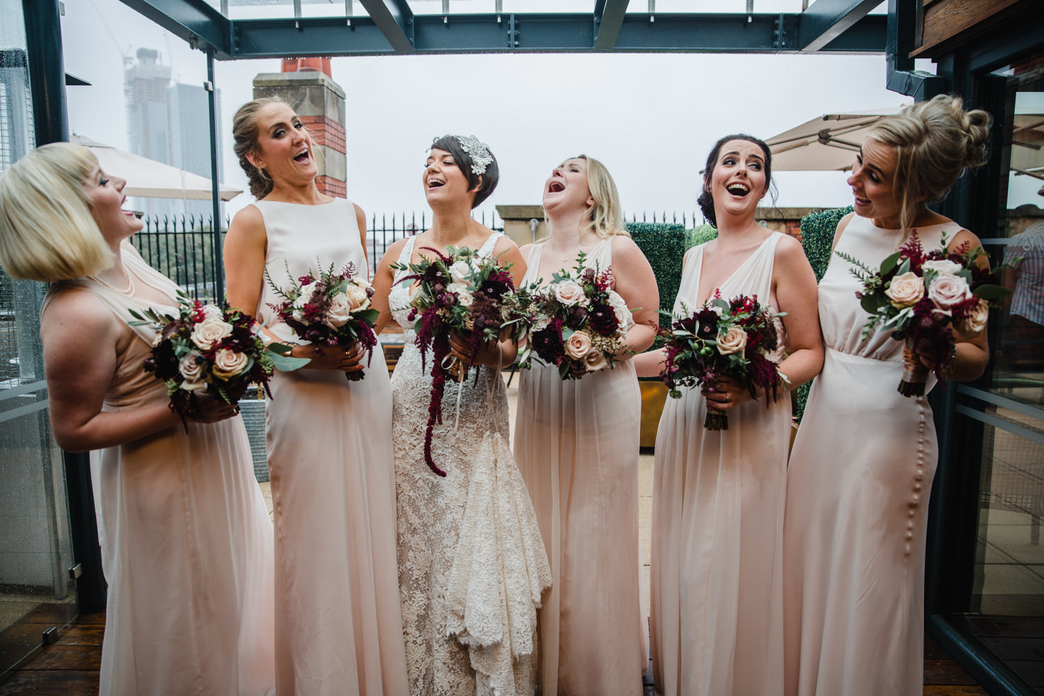 bridal party all laughing for group photograph at great john street hotel