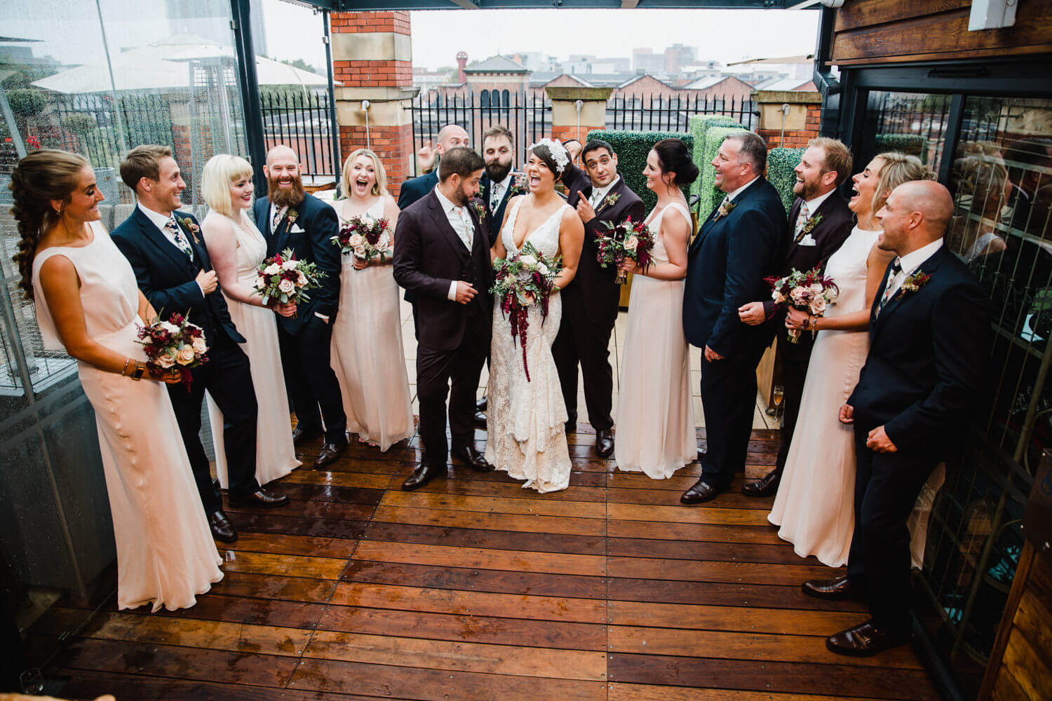 wedding party all together for group photograph as part of the great john street hotel wedding photography