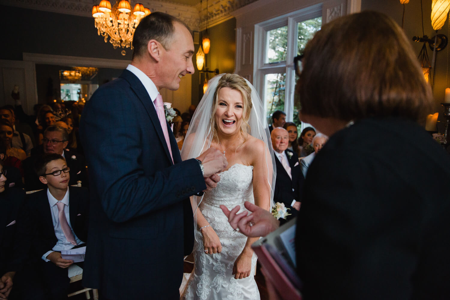 bride sharing joke with registrar during nuptials