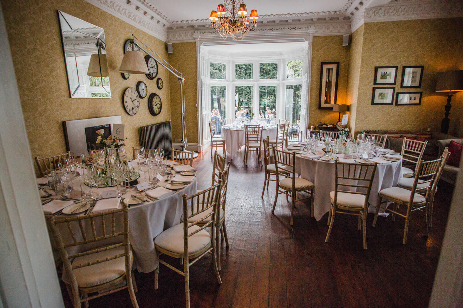 wide angle lens photograph of didsbury house wedding breakfast tables