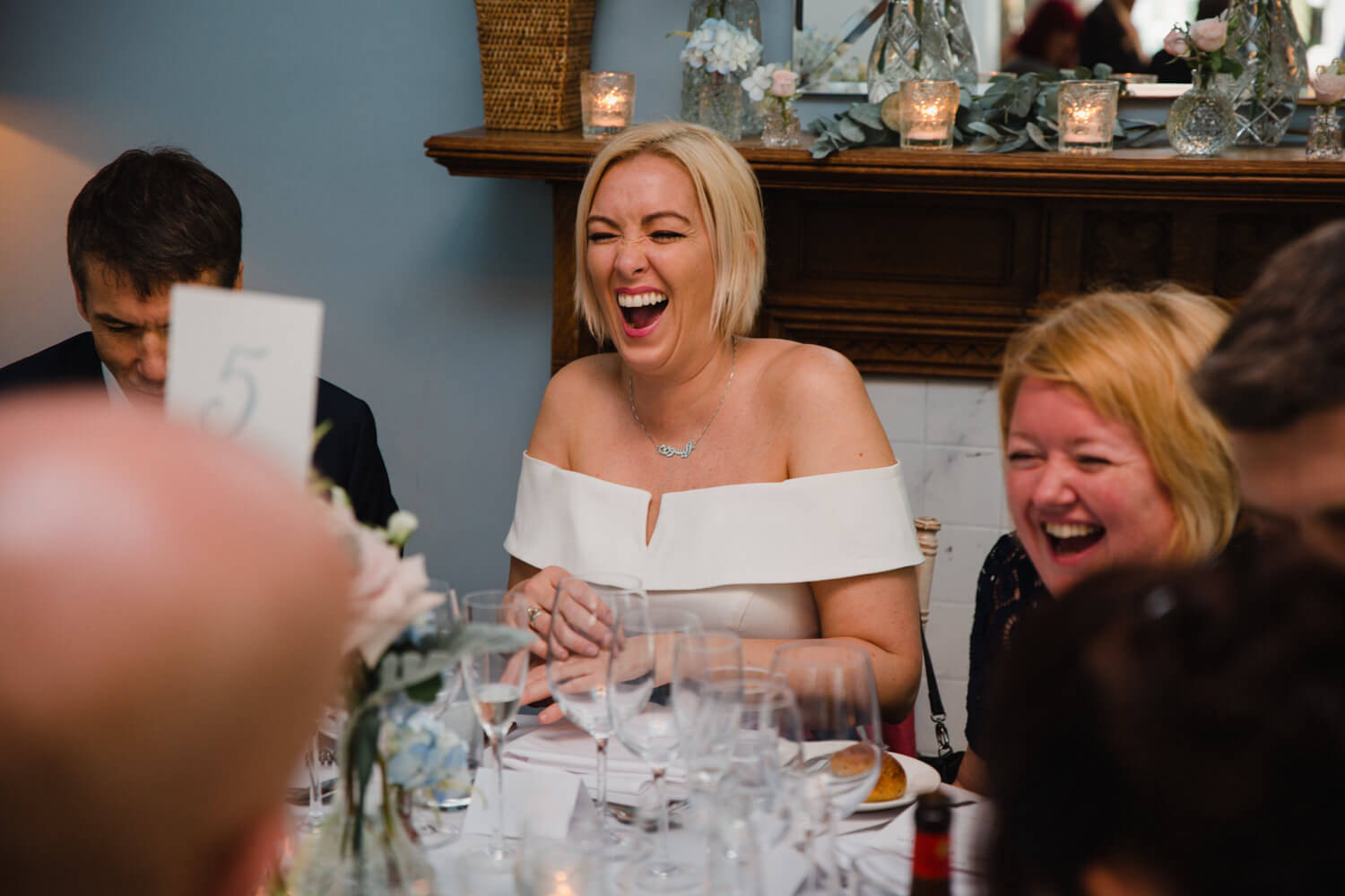 wedding guest laughing and joking