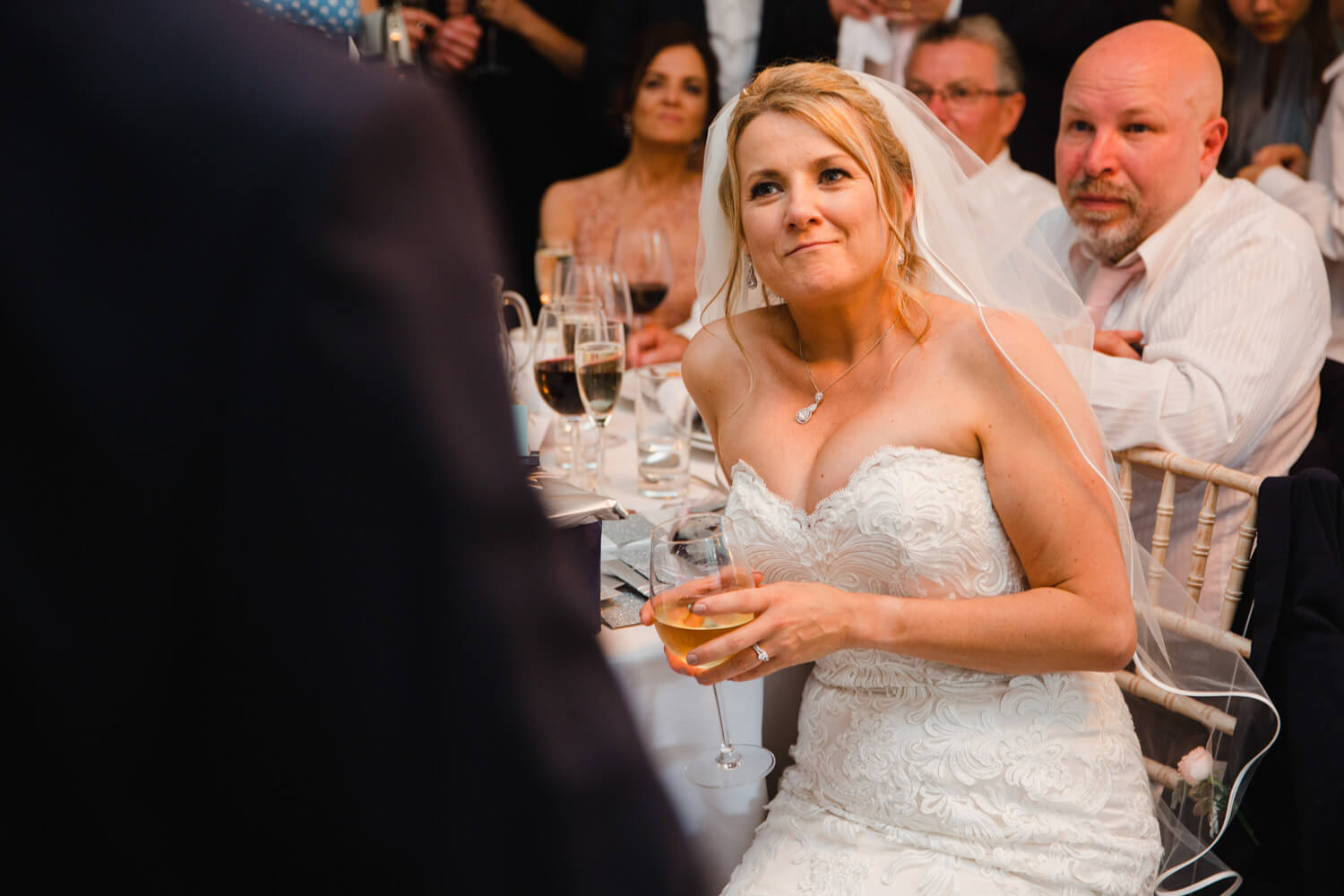 close up photograph of bride listening to speech