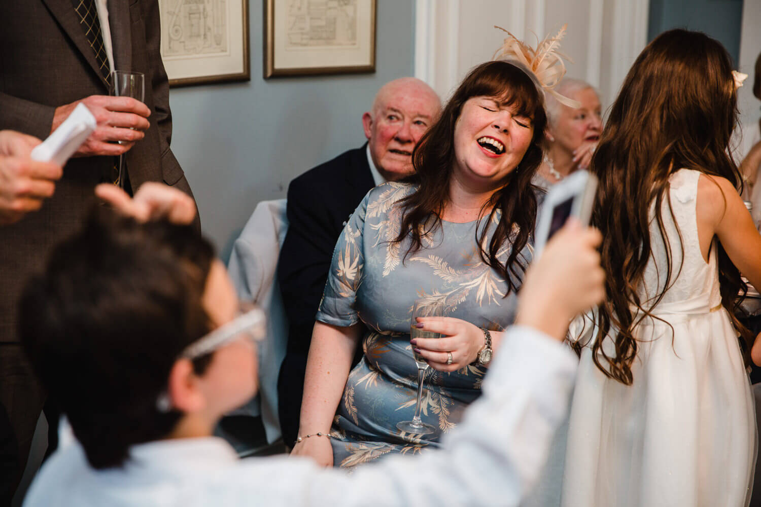 wedding guest laughing at grooms speech