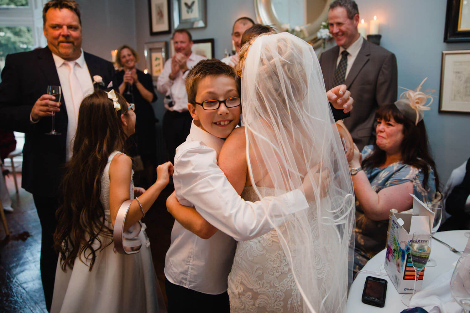 page boy shares hug with bride after wedding speech